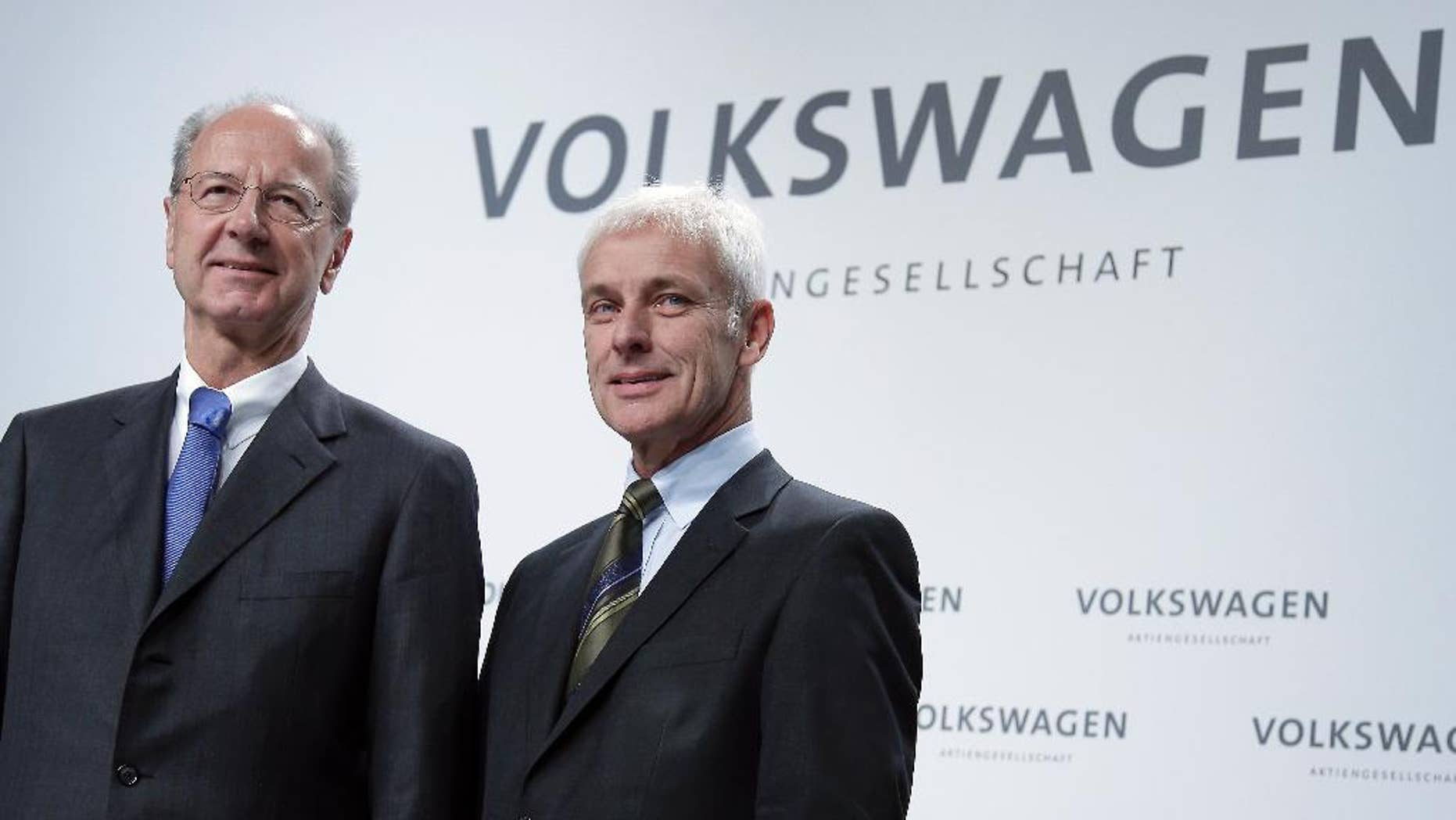 Hans Dieter Poetsch, chairman of the board of directors of Volkswagen, left, and Matthias Mueller, CEO of Volkswagen, right, pose for the media prior to a press conference of the German car manufacturer Volkswagen in Wolfsburg, Germany, Thursday, Dec. 10, 2015. (AP Photo/Michael Sohn)