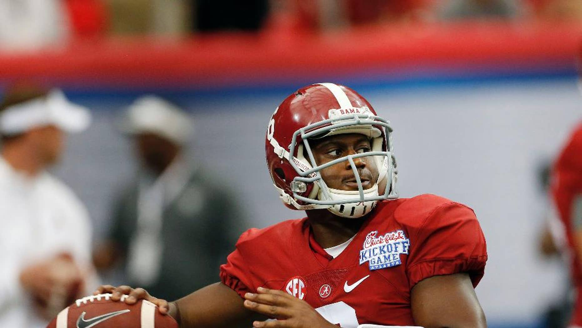 Alabama quarterback Blake Sims (6) warms up before an NCAA college football game against West Virginia Saturday, Aug. 30, 2014, in Atlanta.  (AP Photo/John Bazemore)