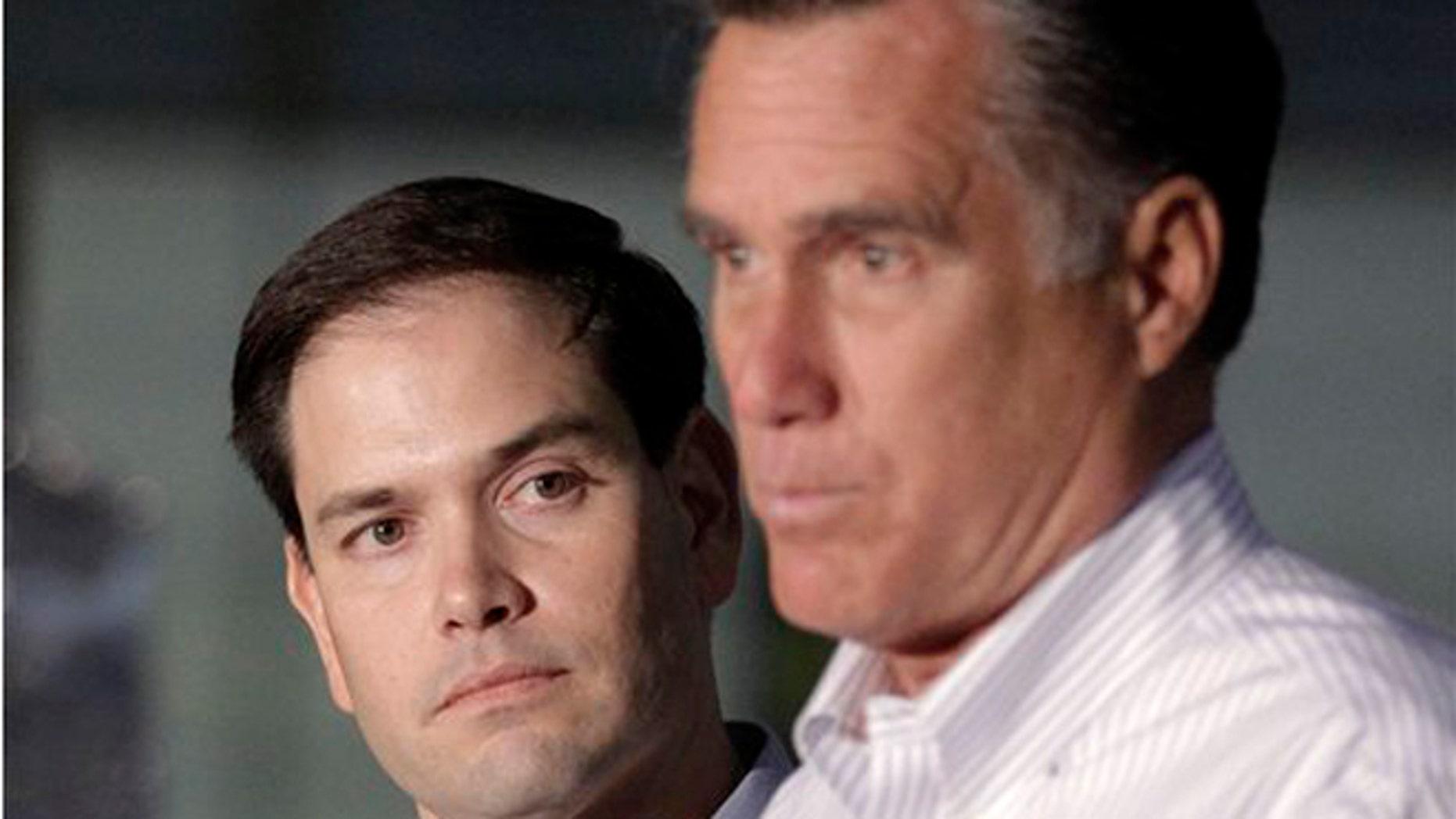 2012: Sen. Marco Rubio, R-Fla. listens at left as GOP presidential candidate Mitt Romney speaks in Aston, Pa.