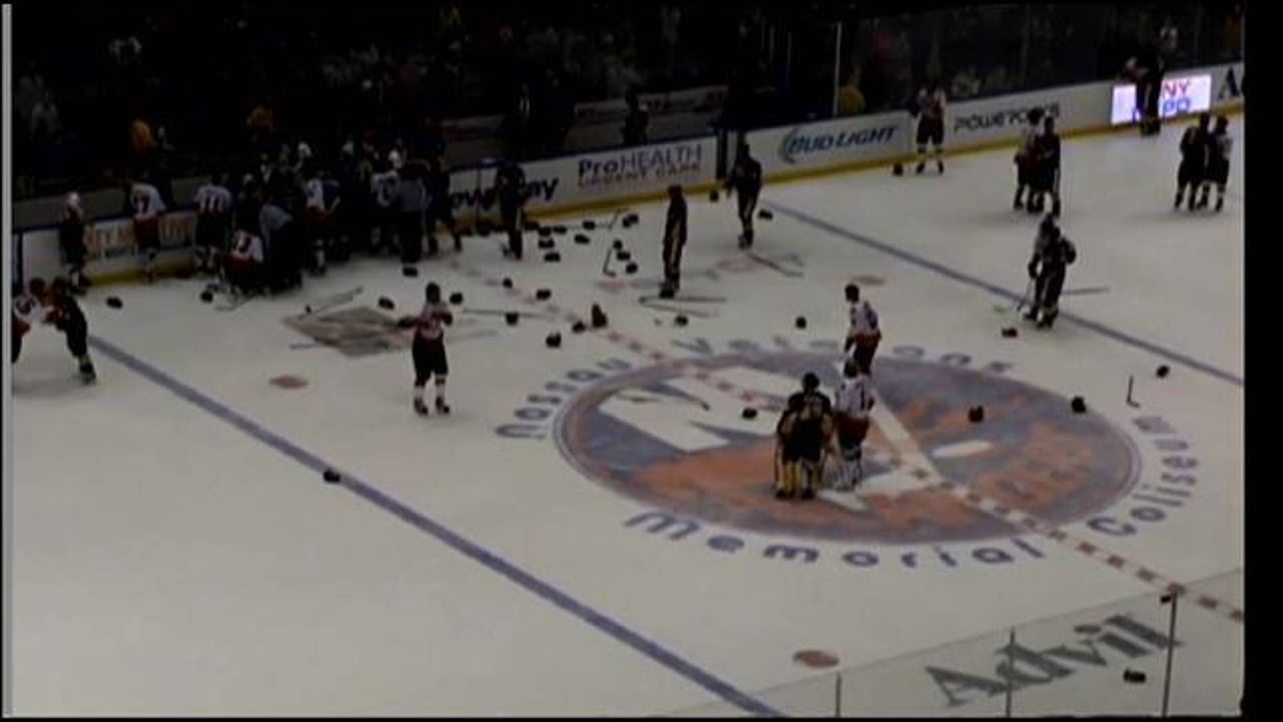April 6, 2014: Officials try to break up a brawl between hockey teams representing the NYPD and the FDNY at Nassau Coliseum in Uniondale, Long Island (MyFoxNY.com)