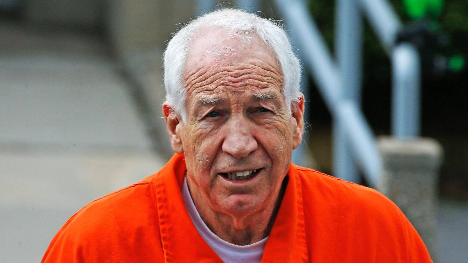 FILE - In this Monday, May 2, 2016, file photo, former Penn State University assistant football coach Jerry Sandusky leaves the Centre County Courthouse after a hearing of arguments on his request for an evidentiary hearing as he seeks a new trial in Bellefonte, Pa. Sandusky has been moved Feb. 27, 2017 from a maximum-security prison to a medium-security facility, State Correctional Institution-Somerset, in western Pennsylvania. (AP Photo/Gene J. Puskar)