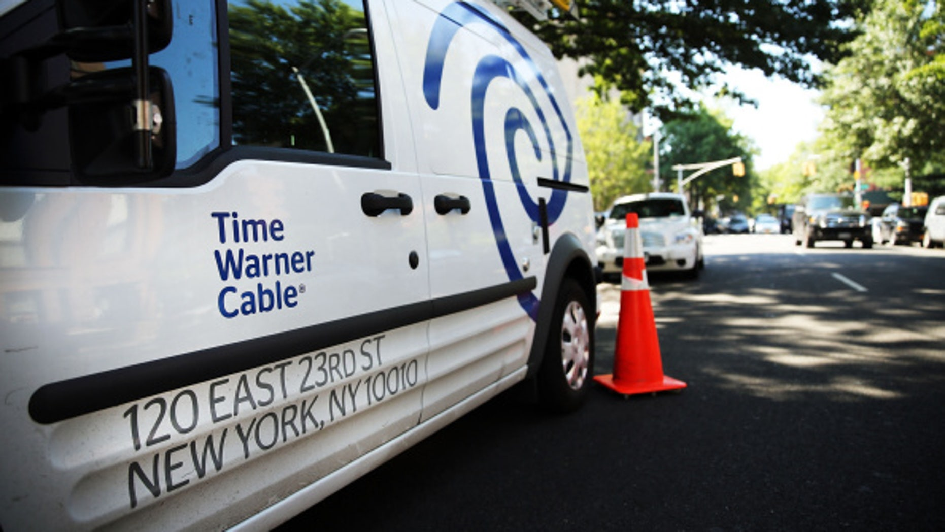 NEW YORK, NY - AUGUST 27:  A Time Warner Cable truck is viewed in Brooklyn on August 27, 2014 in New York City.  Time Warner Cable, which has 11.4 million subscribers in the United States, suffered a massive power outage Wednesday morning across the nation. While customers appeared to have power back by mid-morning, thousands had lost internet service for the duration of the outage. In a deal that is valued at $45.2 billion, Time Warner Cable is attempting to merge with Comcast.  (Photo by Spencer Platt/Getty Images)