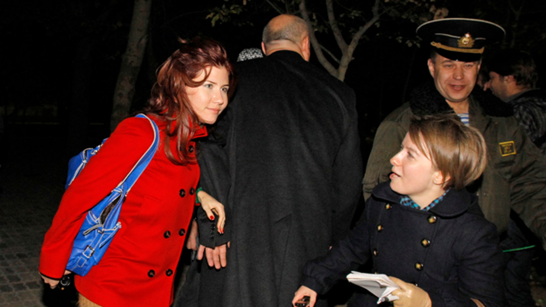Oct. 7, 2010: Anna Chapman, left, a Russian national who was deported from the U.S. this summer for alleged spying for Russia, with AP reporter Nataliya Vasilyeva at the farewell ceremony for a U.S. astronaut and two Russian cosmonauts at the Russian leased Baikonur cosmodrome, Kazakhstan.