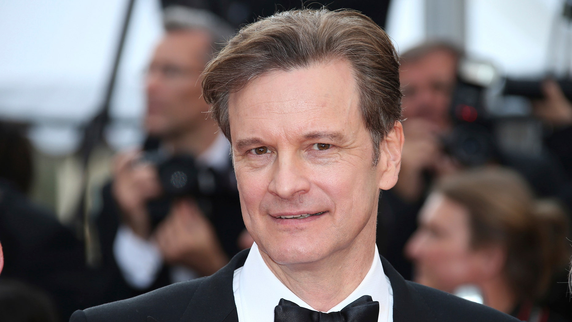 """In this Monday, May 16, 2016 file photo, actor Colin Firth poses for photographers upon arrival at the screening of the film Loving at the 69th international film festival, Cannes, southern France. British actor Colin Firth says he has taken Italian citizenship as a """"sensible"""" move amid global political uncertainty."""