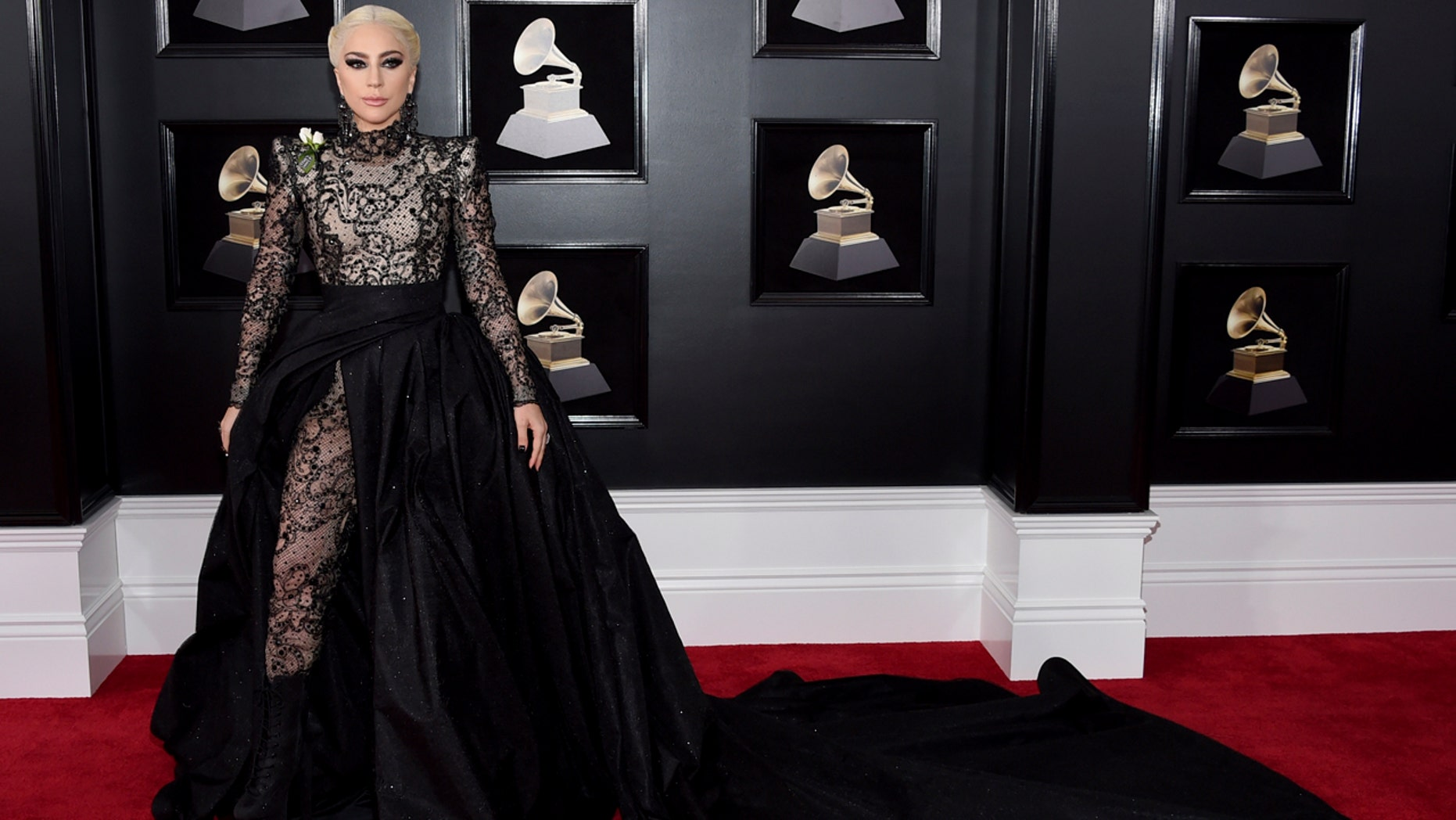 Lady Gaga turned heads in a black, satin ball gown with a sheer and embellished, high neck top. The skirt of the dress was also featured embellished, sheer pants underneath.