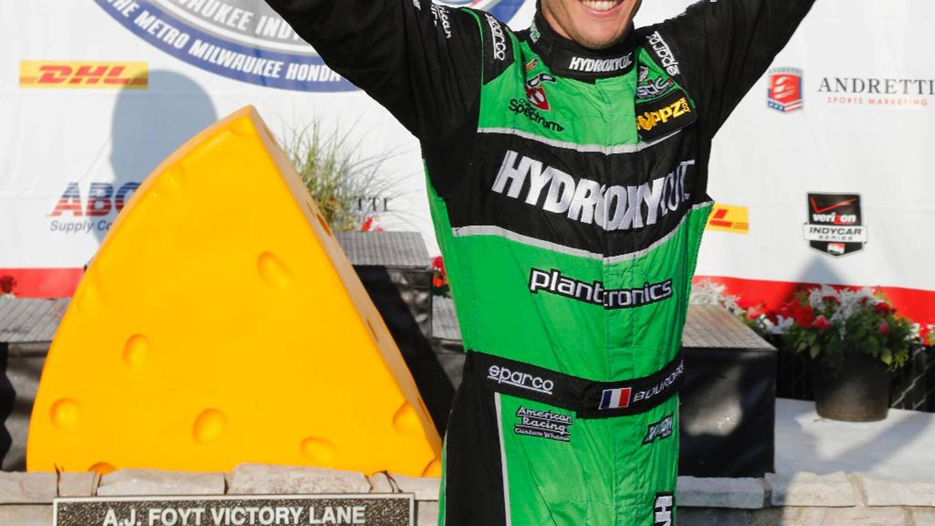 Sebastien Bourdais celebrates in the winners circle after the IndyCar Series race at the Milwaukee Mile in West Allis, Wis., Sunday, July 12, 2015. (AP Photo/Jeffrey Phelps)