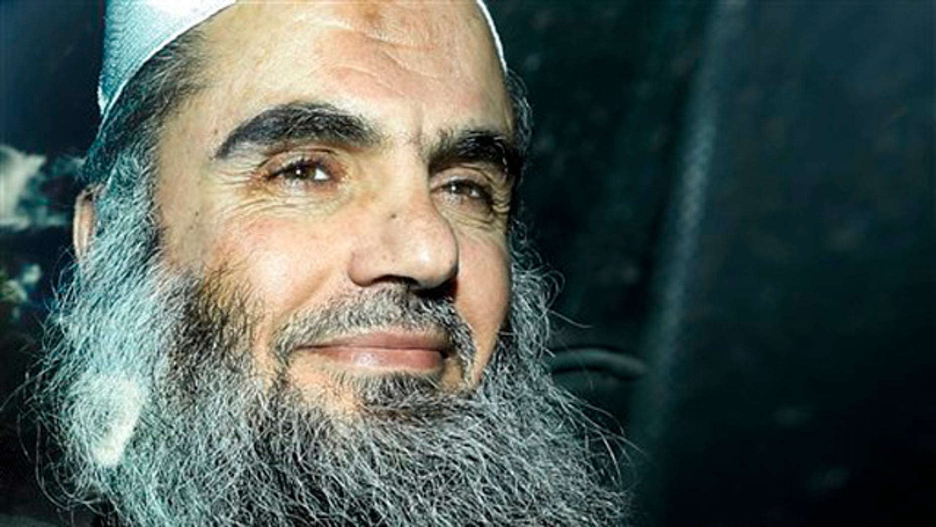 April 17, 2012: Abu Qatada is driven away after being refused bail at a hearing at London's Special Immigration Appeals Commission, which handles deportation and security cases, in London.