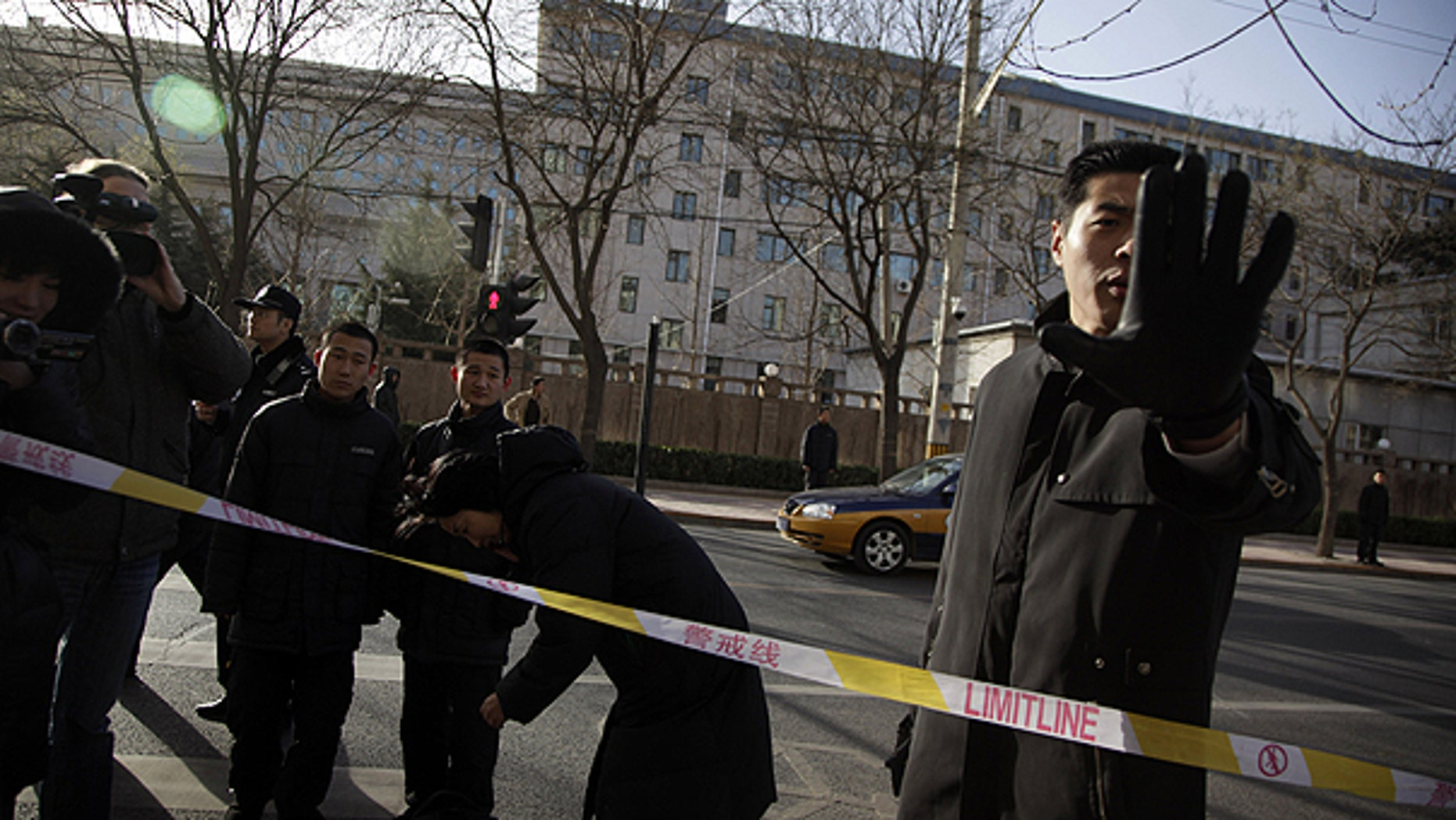 Dec. 10: A plain clothes security person blocks a photographer in an area cordoned off for journalists to work outside the residential compound where Liu Xia, the wife of Nobel Peace Prize winner Liu Xiaobo lives in Beijing, China.