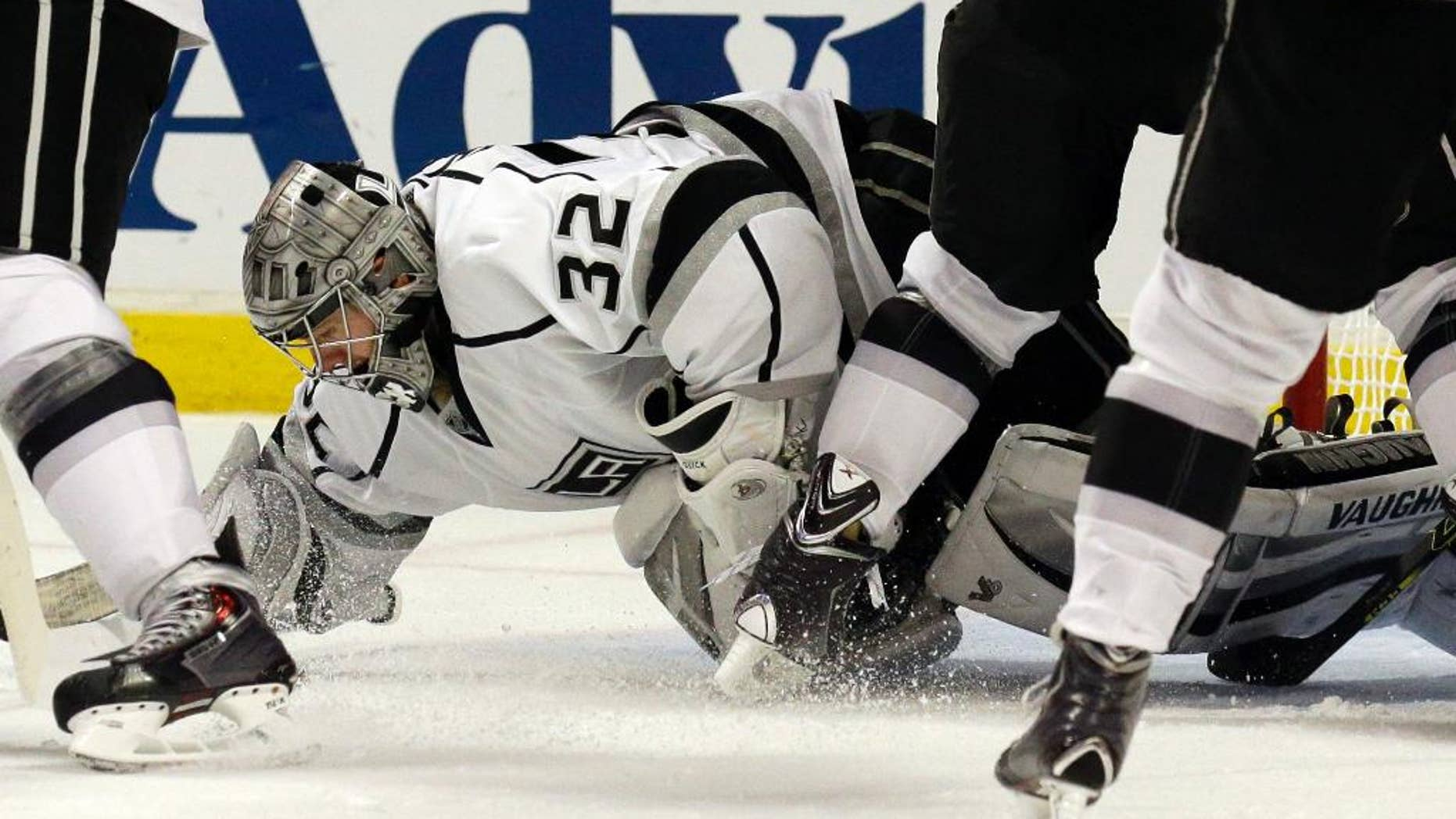 Los Angeles Kings goalie Jonathan Quick (32) saves a shot by Chicago Blackhawks' Michal Handzus (26) during the second period in Game 2 of the Western Conference finals in the NHL hockey Stanley Cup playoffs in Chicago on Wednesday, May 21, 2014. (AP Photo/Nam Y. Huh)