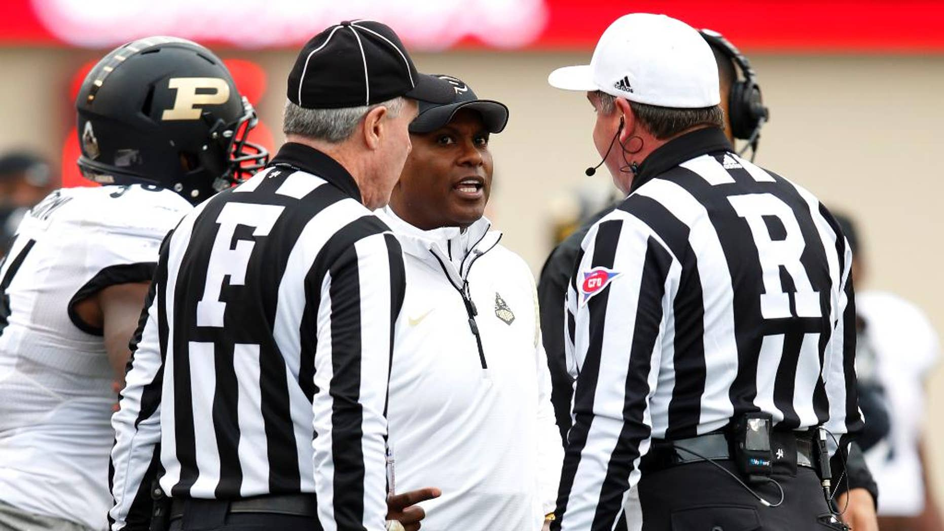 Purdue head coach Darrell Hazell reacts to a call by the officials during the second half of play against Indiana in an NCAA college football game at Memorial Stadium in Bloomington, Ind., Saturday, Nov. 29, 2014. (AP Photo/John Sommers II)