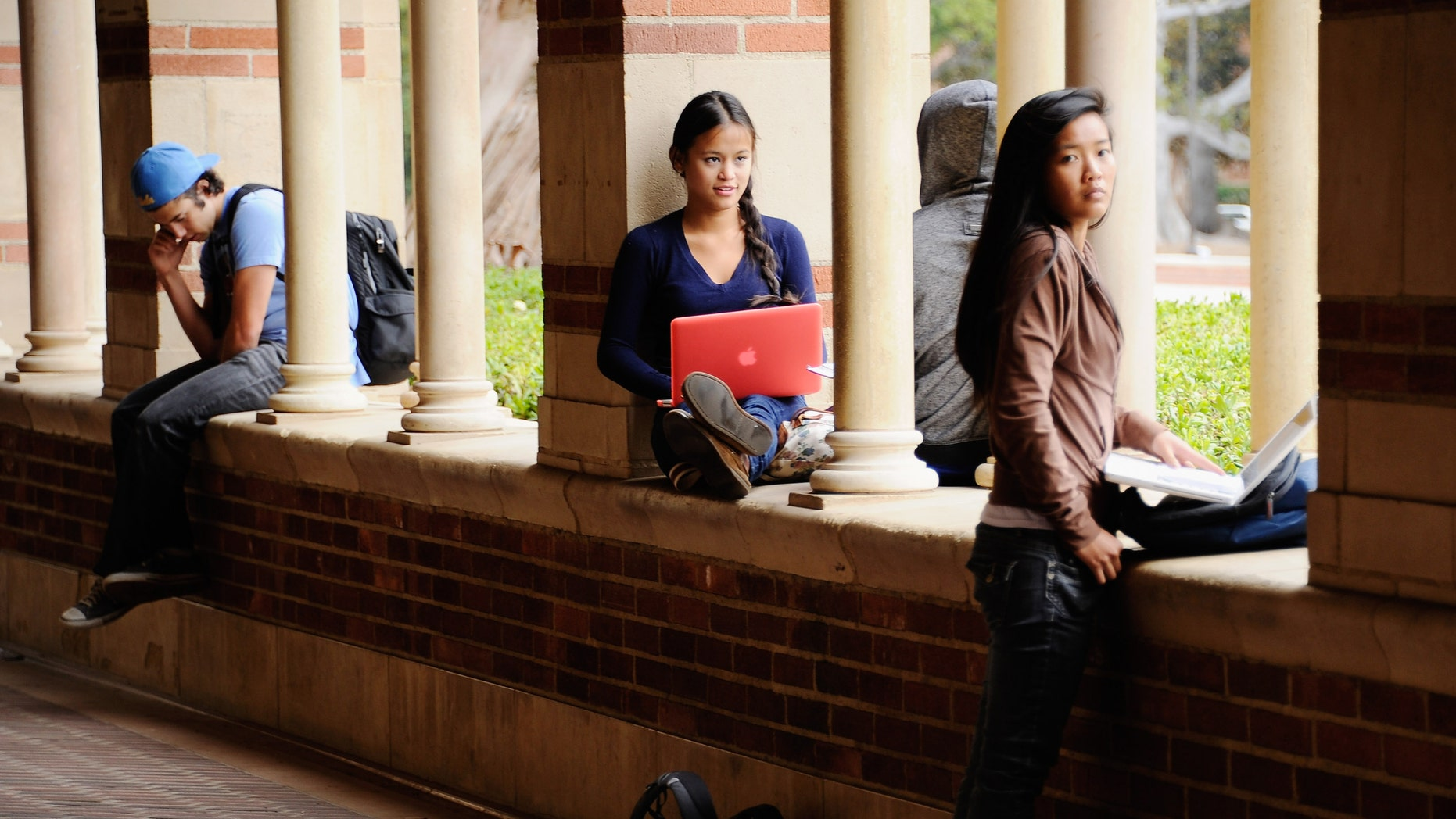 LOS ANGELES, CA - APRIL 23:  Students take a break at Royce Hall on the campus of UCLA on April 23, 2012 in Los Angeles, California. According to reports, half of recent college graduates with bachelor's degrees are finding themselves underemployed or jobless.  (Photo by Kevork Djansezian/Getty Images)