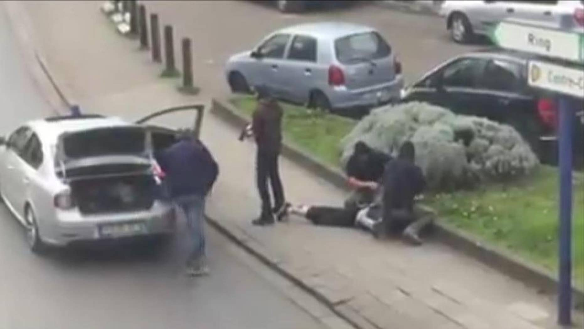 "In this image made from video, police arrest a man in the Anderlecht area of Brussels, Friday, April 8, 2016. A fugitive suspect in the Nov. 13 Paris attacks was arrested in Belgium on Friday, French police officials said, after a raid Belgian authorities said was linked to the deadly March 22 Brussels bombings.  The suspect, Mohamed Abrini, is believed to be the mysterious ""man in the hat"" who escaped the double bombing at the Zaventem airport, according to one of the French officials. (Sebastian Kamran via AP)"