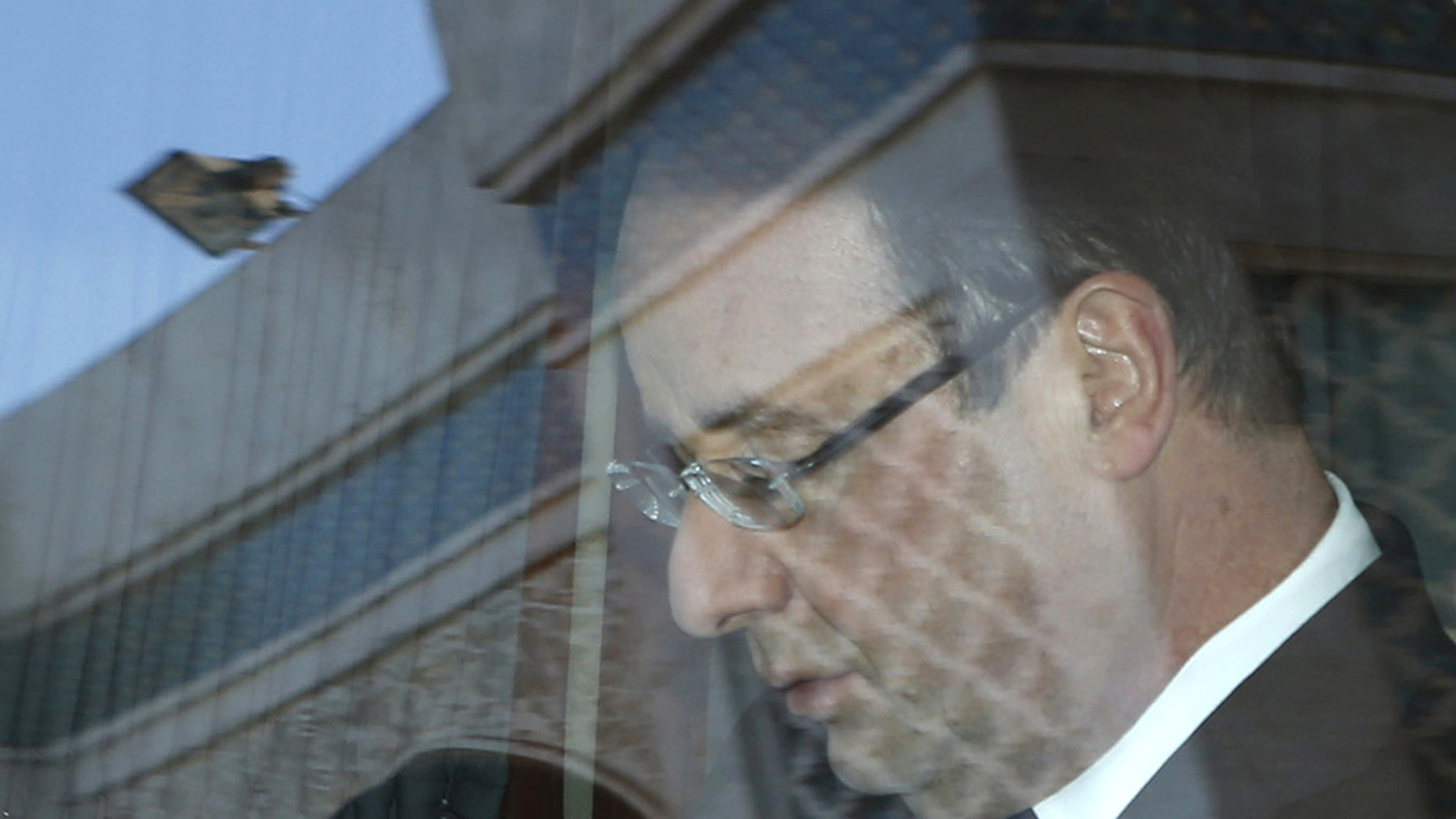 French President Francois Hollande looks at his mobile phone as he sits in a limousine after visiting the Hassan II mosque in Casablanca, Morocco Thursday, April 4, 2013. French President Hollande is on the  second-day of a state visit to Morocco. (AP Photo/Youssef Boudlal/Pool)