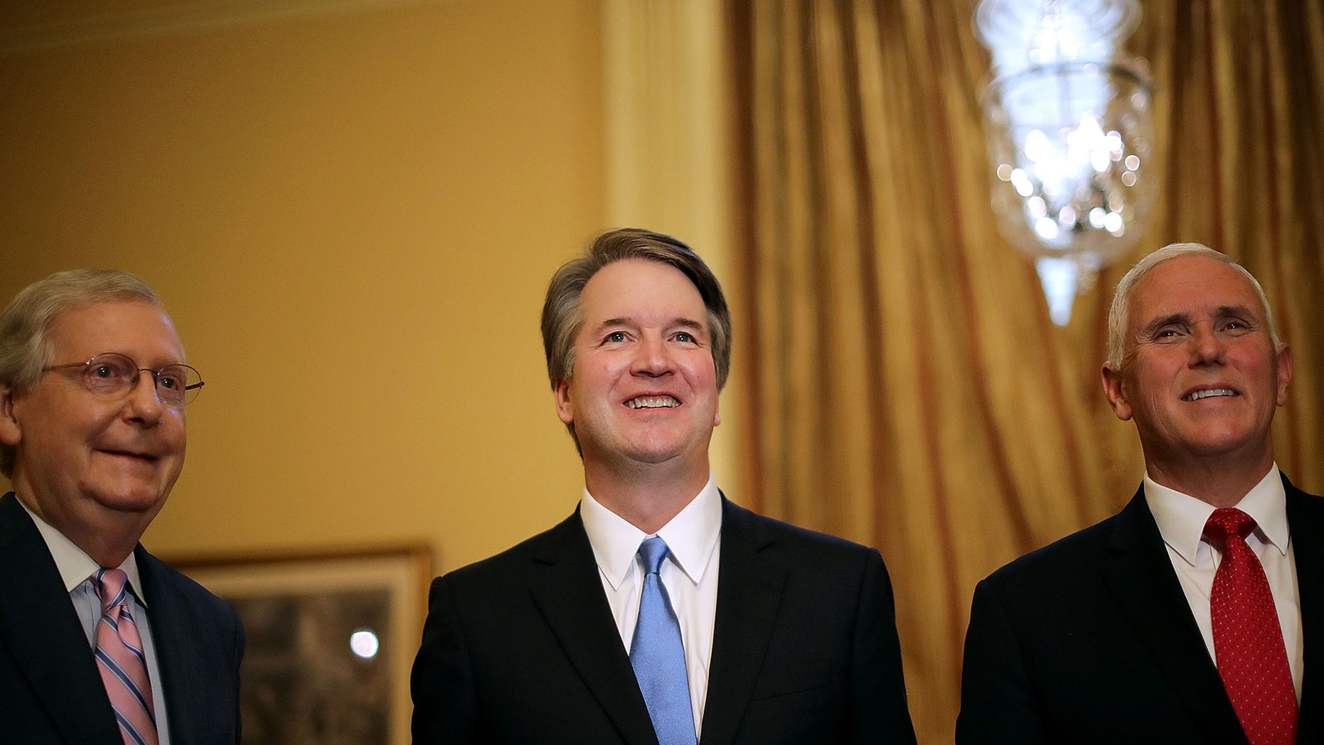 WASHINGTON, DC - JULY 10: (L-R) Senate Majority Leader Mitch McConnell (R-KY), Judge Brett Kavanaugh and Vice President Mike Pence pose for photographs before a meeting in McConnell's office in the U.S. Capitol July 10, 2018 in Washington, DC. U.S. President Donald Trump nominated Kavanaugh to succeed retiring Supreme Court Associate Justice Anthony Kennedy. (Photo by Chip Somodevilla/Getty Images)
