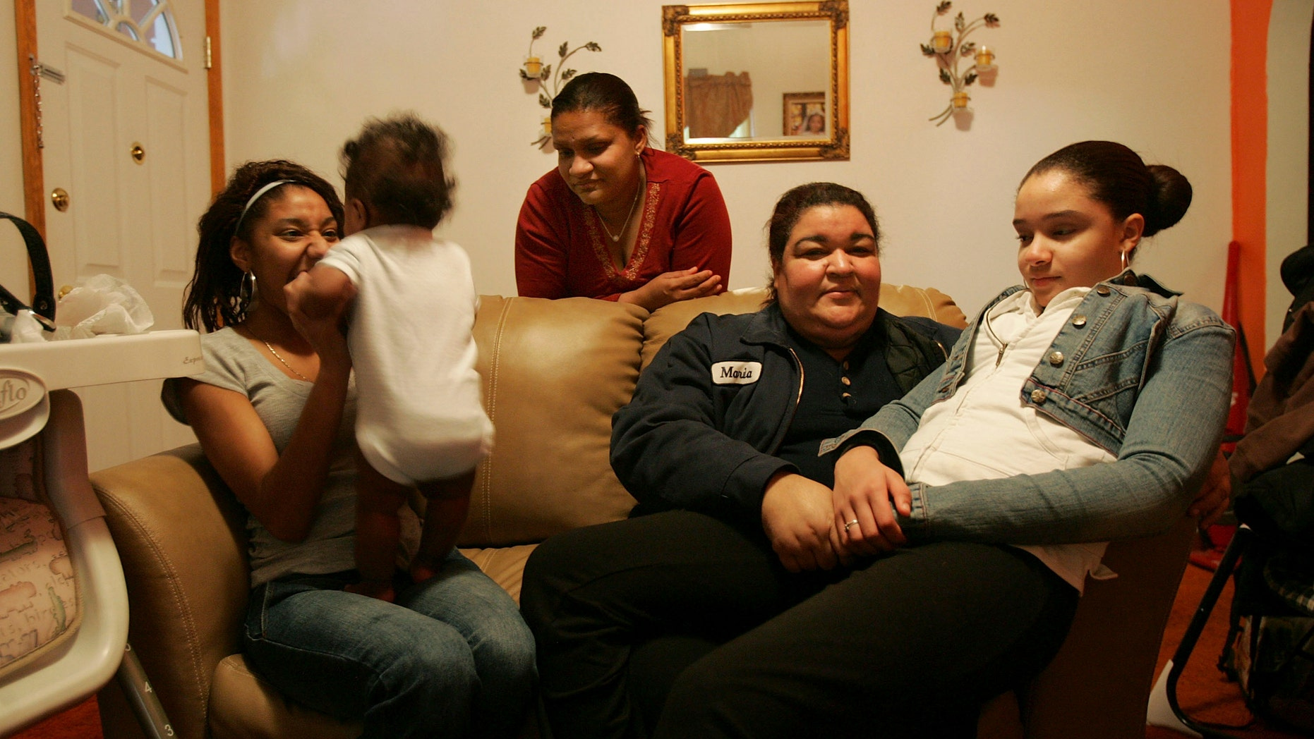 HAZLETON, PA - MARCH 14: Members of the Castillo family sit in their living room March 14, 2007 in Hazleton, Pennsylvania.   (Photo by Spencer Platt/Getty Images)