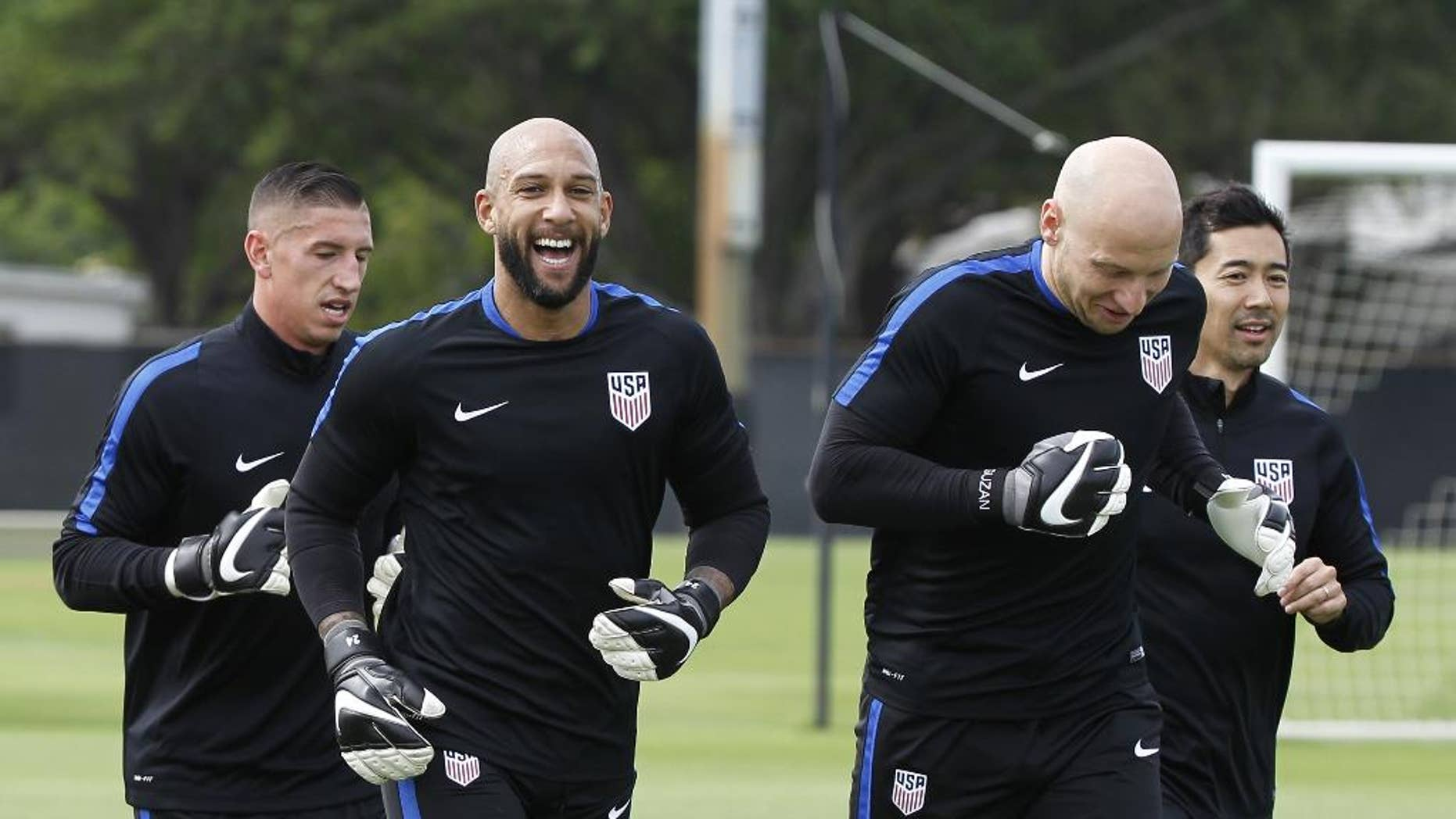 FILE - In this March 21, 2016, file photo, U.S. soccer goalkeepers Tim Howard, left, and Brad Guzan, warm up during a training sesson at Barry University in Miami Shores, Fla. Guzan is set to start ahead of veteran Tim Howard for the U.S. national team in the upcoming Copa America tournament, coach Jurgen Klinsmann announced Saturday, May 21, 2016. (AP Photo/Marta Lavandier, File)