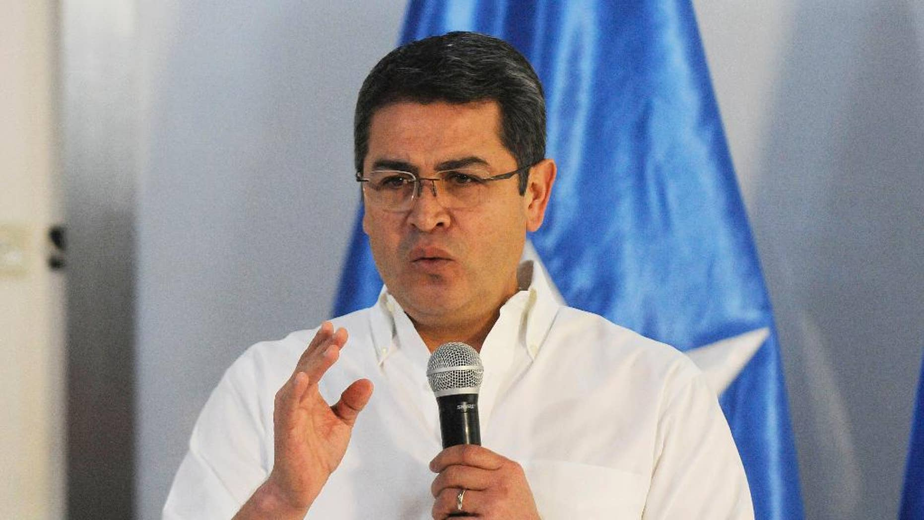 The President of Honduras, Juan Orlando Hernandez talks during a press conference where he announced his intention to run for another term, in Tegucigalpa, Honduras, Wednesday Nov. 9, 2016. Hernandez has announced his intention to run for another term, a year after a controversial Supreme Court ruling voided a longtime constitutional ban on presidential re-election. (AP Photo/Fernando Antonio)
