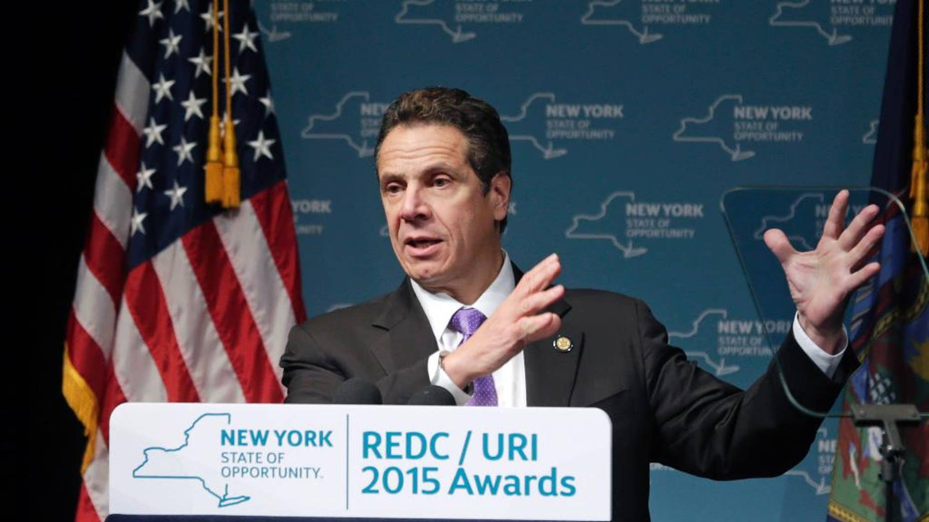 """FILE - In this Dec. 10, 2015, file photo, New York Gov. Andrew Cuomo speaks during an economic development awards ceremony in Albany, N.Y. After the NYCLU filed its lawsuit in 2011, Cuomo saw it as an opportunity to improve New York's prison standards and instructed his staff to negotiate. New York prison officials agreed Wednesday, Dec. 16, 2015, to overhaul their use of solitary confinement, offering a broad slate of reforms aimed at reducing the number of inmates sent to """"the box,"""" limiting the amount of time they can spend there and providing counseling to help long-term solitary inmates adjust to life on the outside. (AP Photo/Mike Groll, File)"""