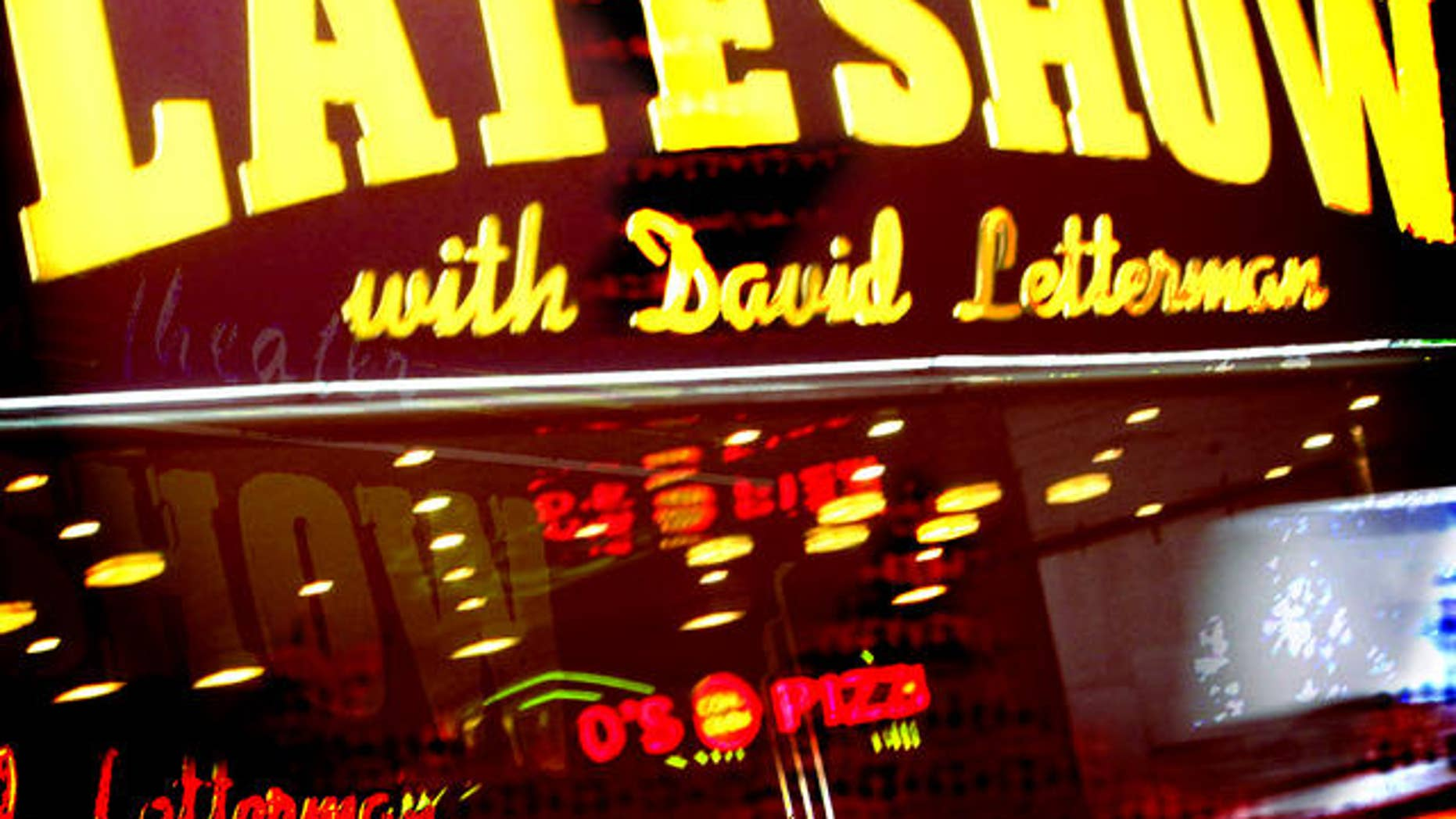 """** FILE ** In this  Jan. 17, 2008 file photo, television talk show host David Letterman is seen outside of The Ed Sullivan Theater during a taping of """"The Late Show with David Letterman"""", in New York."""