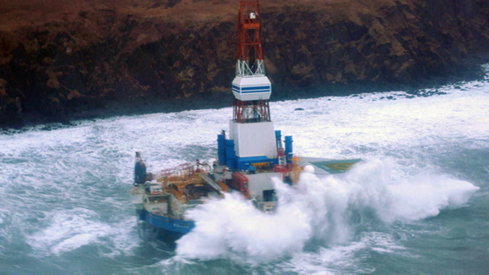 Jan. 1: This image provided by the U.S. Coast Guard shows the Royal Dutch Shell drilling rig Kulluk aground off a small island near Kodiak Island.