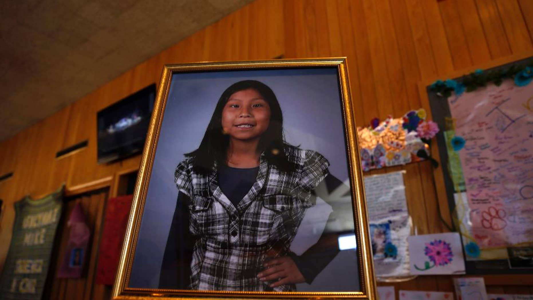 FILE - In this May 6, 2016 file photo a portrait of Ashlynne Mike is on display inside the lobby of the Farmington Civic Center in Farmington, N.M. Mike's father has sued the tribe for failing to have an emergency notification system that he claims would have saved his daughter's life. (Jon Austria  /The Daily Times via AP, File)