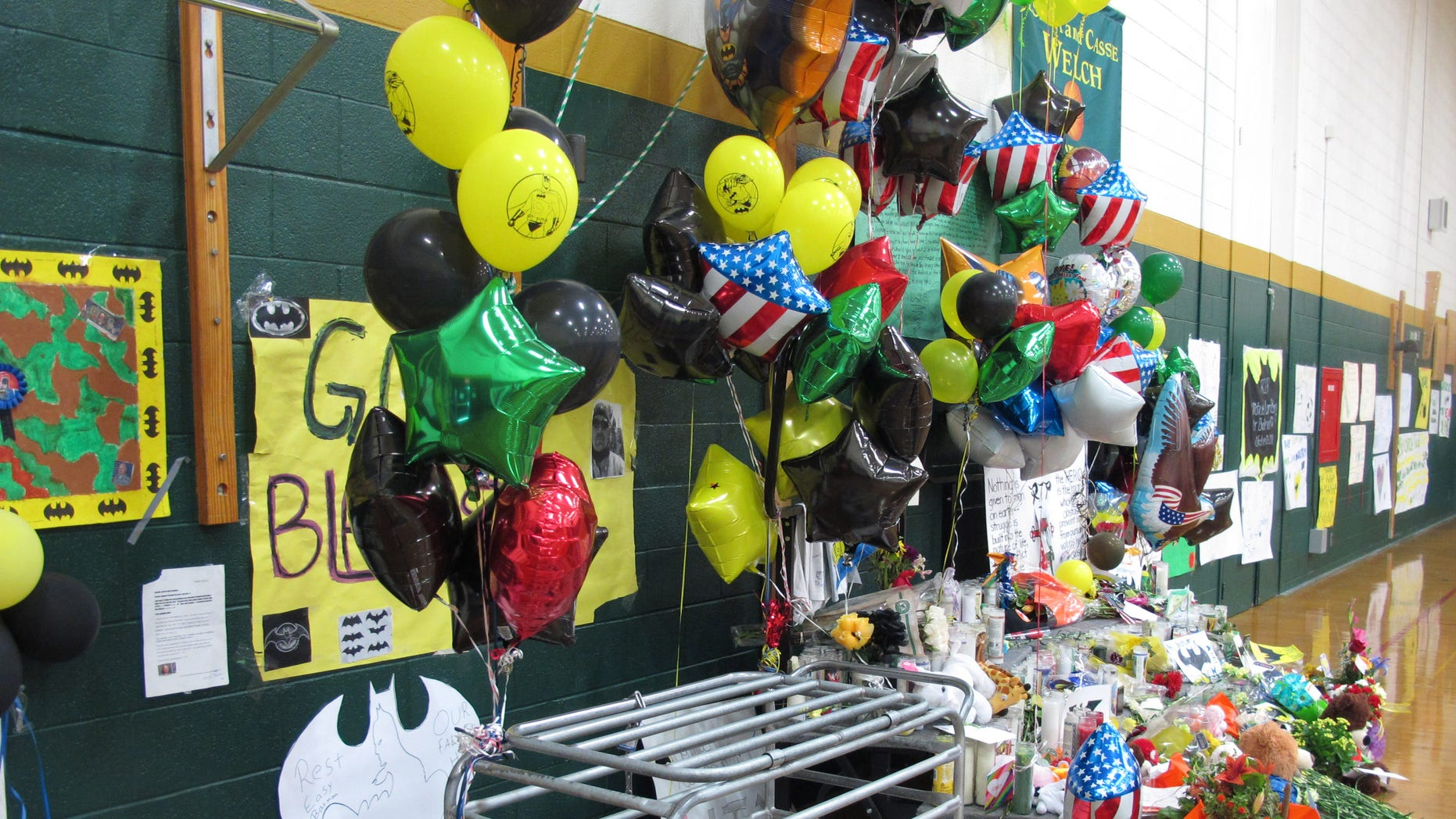 Oct. 24, 2013: This photo shows a memorial to fallen teacher Michael Landsberry, that Sparks Middle School officials moved to the gymnasium.