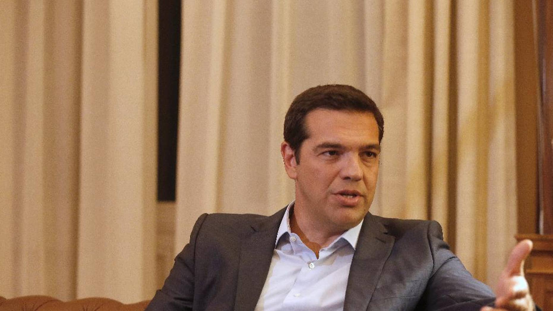 Greek Prime Minister Alexis Tsipras, meets with Greek President Prokopis Pavlopoulos, in Athens, Thursday, Aug. 20, 2015. Tsipras announced his government's resignation and called early elections Thursday, seeking to consolidate his mandate to implement a new three-year international bailout that sparked a rebellion within his radical left Syriza party. (AP Photo/Petros Giannakouris)