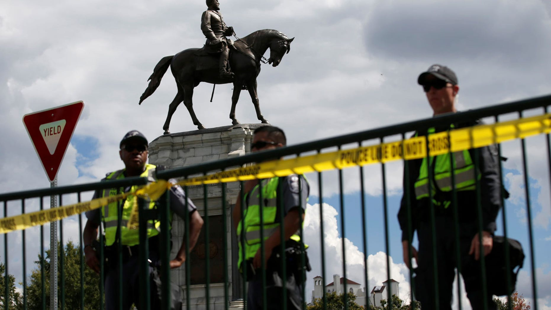 FILE 2017: Police stand in front of the statue of Confederate General Robert E. Lee in Richmond, Virginia