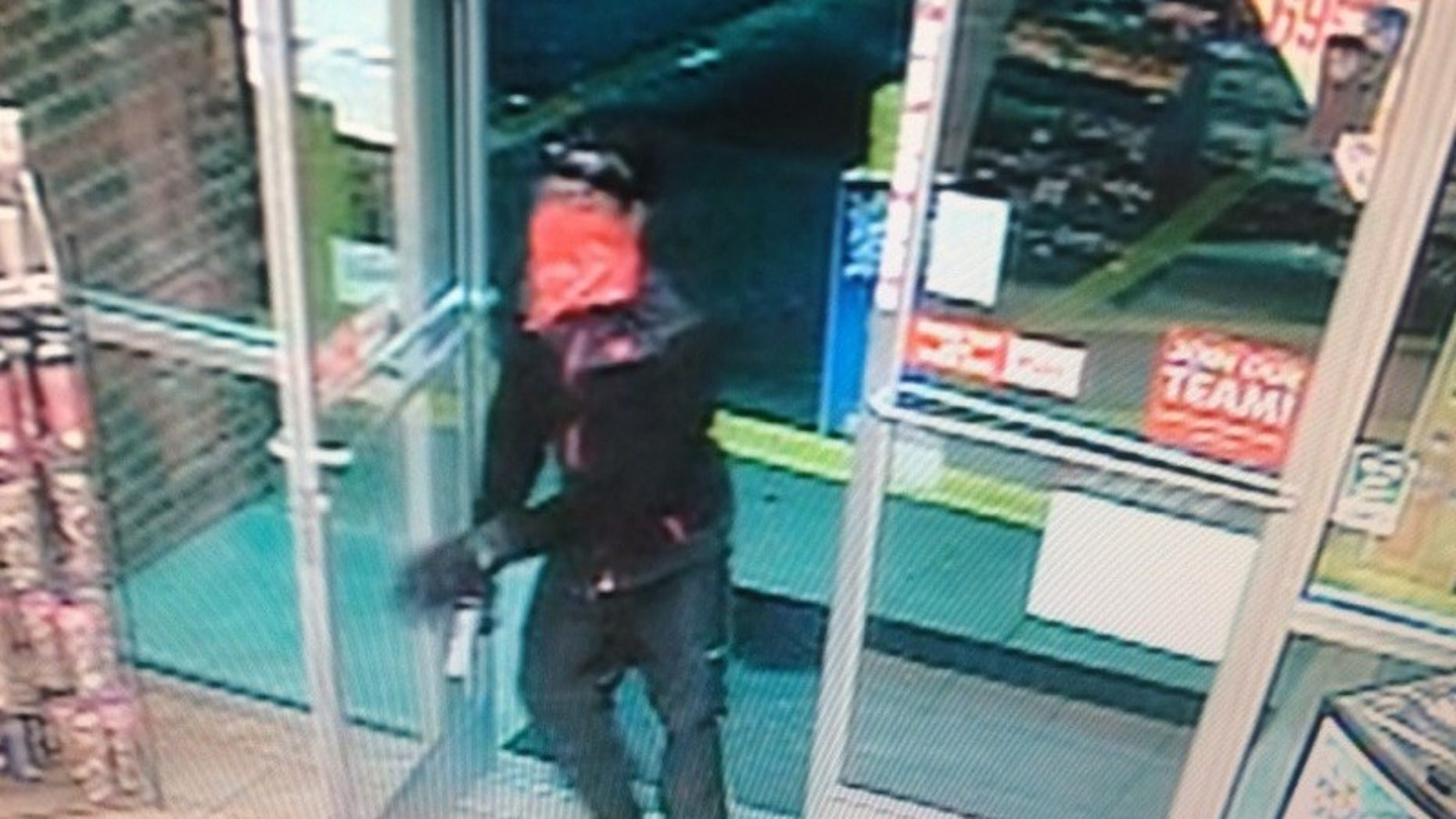 The suspect entering the store right before the kidnapping.