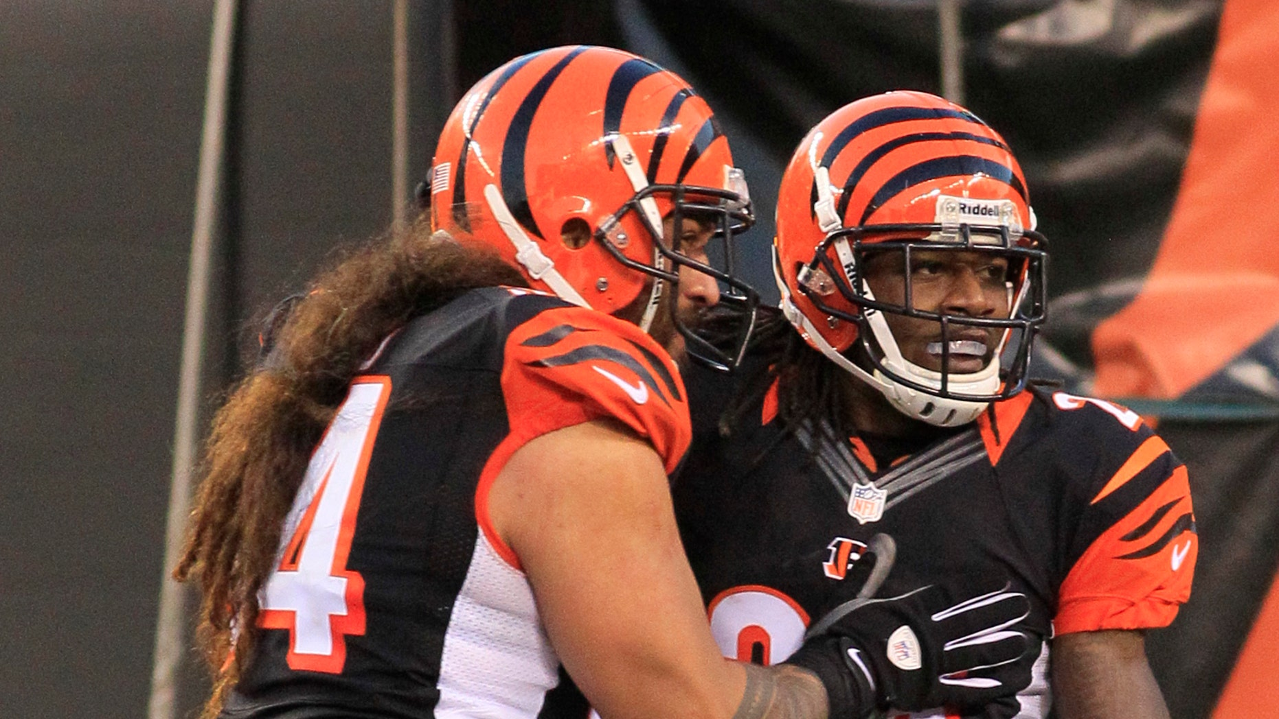 Cincinnati Bengals cornerback Adam Jones (24) is congratulated by defensive tackle Domata Peko (94) after Jones returned an interception 60 yards for a touchdown in the second half of an NFL football game against the New York Jets, Sunday, Oct. 27, 2013, in Cincinnati. Cincinnati won 49-9. (AP Photo/Tom Uhlman)