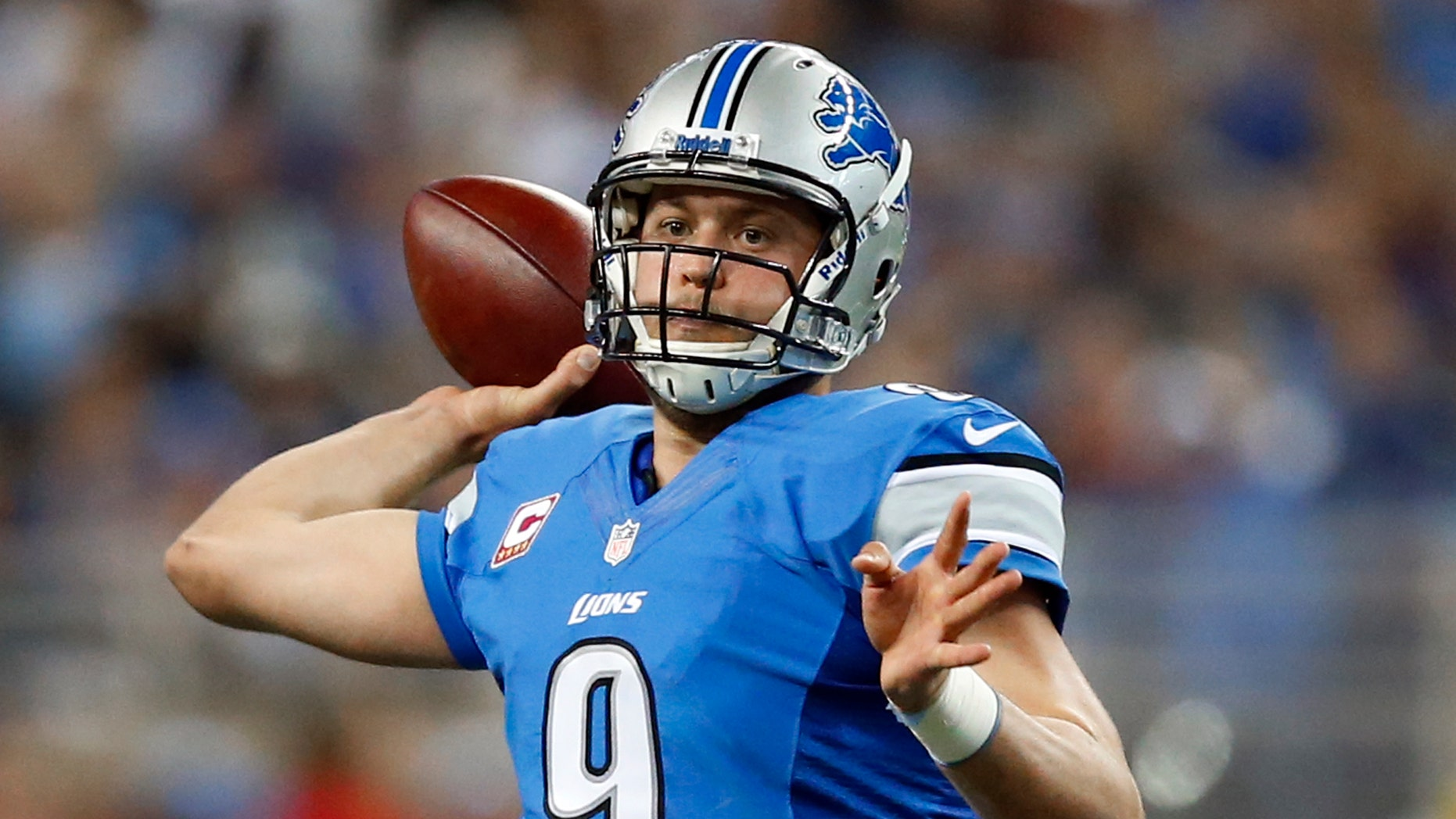 Detroit Lions quarterback Matthew Stafford (9) throws in the first quarter of an NFL football game against the Cincinnati Bengals Sunday, Oct. 20, 2013, in Detroit. (AP Photo/Rick Osentoski)