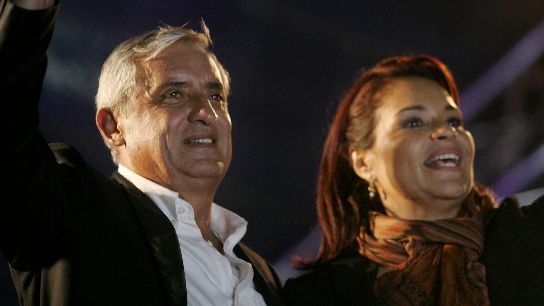 Patriotic Party  presidential candidate, Otto Perez Molina, and vice president candidate Roxana Baldetti celebrate their victory in Guatemala City, Monday, Nov. 7, 2011. Perez Molina won 55 percent of the vote, topping Manuel Baldizon, of the Democratic Freedom Revival party, who had 45 percent with 96 percent of the vote counted Sunday night, according to Guatemala's Supreme Electoral Tribunal. (AP Photo/Rodrigo Abd)