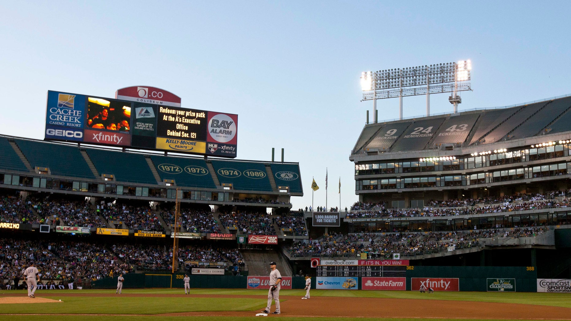 OAKLAND, CA - JUNE 14:  Play is suspended during the fourth inning between the Oakland Athletics and the New York Yankees because of faulty stadium lights in left field at O.co Coliseum on June 14, 2014 in Oakland, California. (Photo by Jason O. Watson/Getty Images)