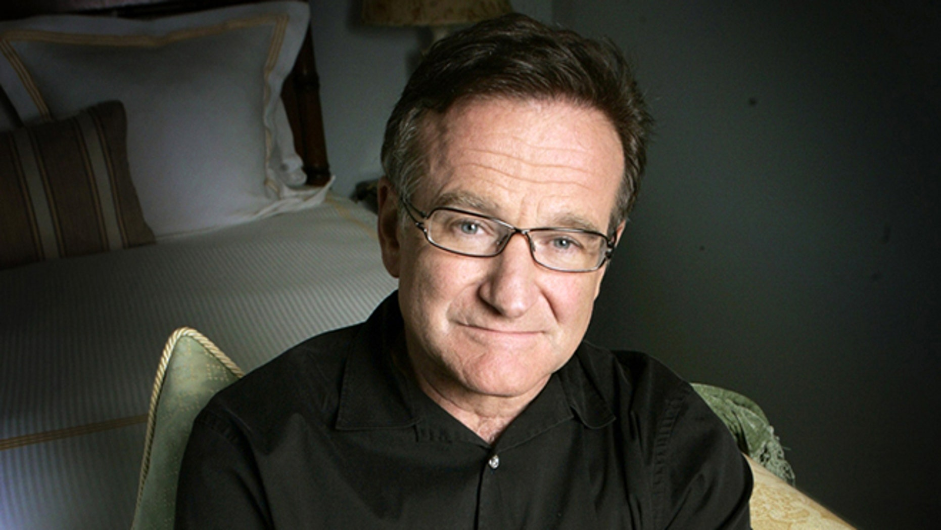 FILE - This June 15, 2007 file photo shows actor and comedian Robin Williams posing for a photo in Santa Monica, Calif. Williams, whose free-form comedy and adept impressions dazzled audiences for decades, died Monday, Aug. 11, 2014, in an apparent suicide. Williams was 63.  (AP Photo/Reed Saxon, File)