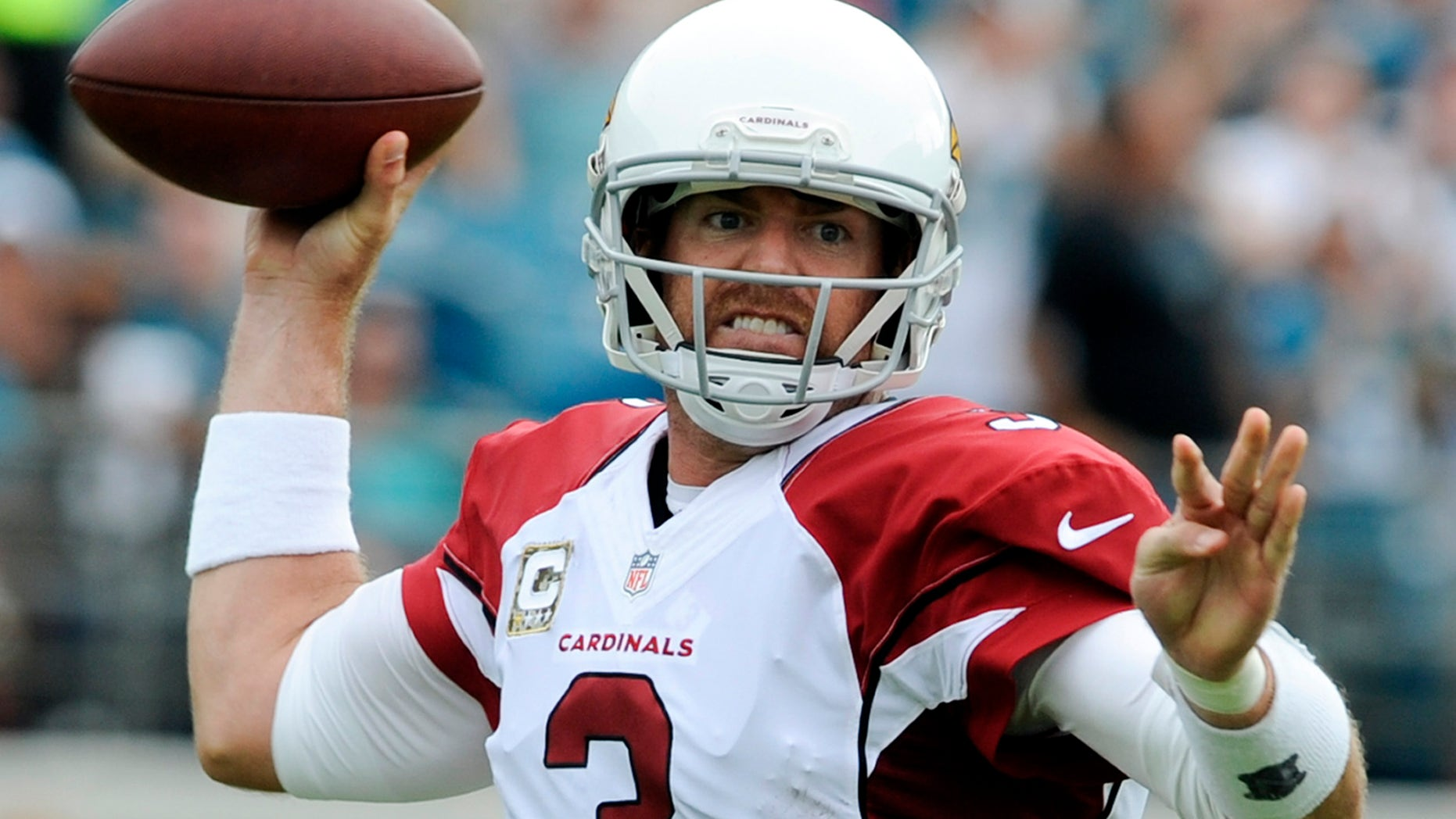 Arizona Cardinals quarterback Carson Palmer (3) throws a pass as he is pressured by the Jacksonville Jaguars defense during the first half of an NFL football game in Jacksonville, Fla., Sunday, Nov. 17, 2013. (AP Photo/Stephen Morton)