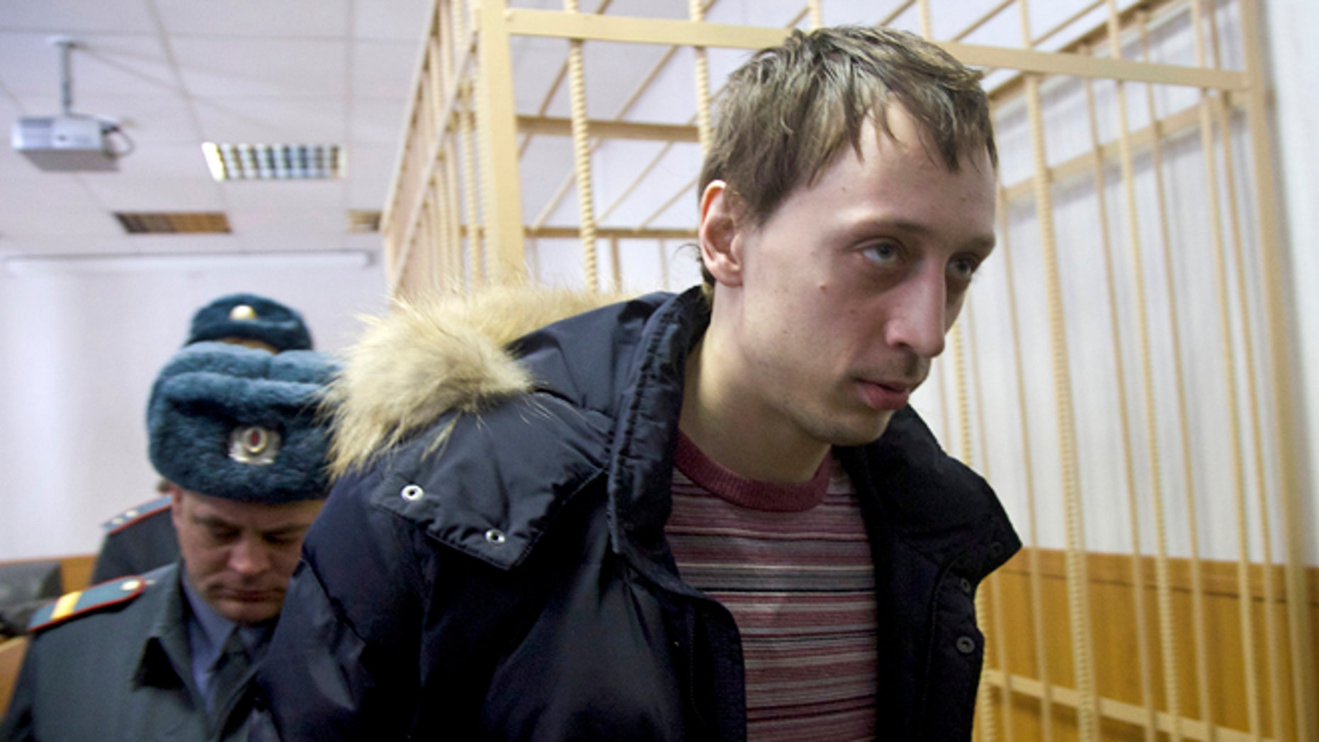 March 7, 2013: Pavel Dmitrichenko, foreground, is escorted out of a courtroom in Moscow, Russia. The star dancer accused of masterminding the attack on the Bolshoi ballet chief acknowledged Thursday that he gave the go-ahead for the attack, but told a Moscow court that he did not order anyone to throw acid on the artistic director's face.