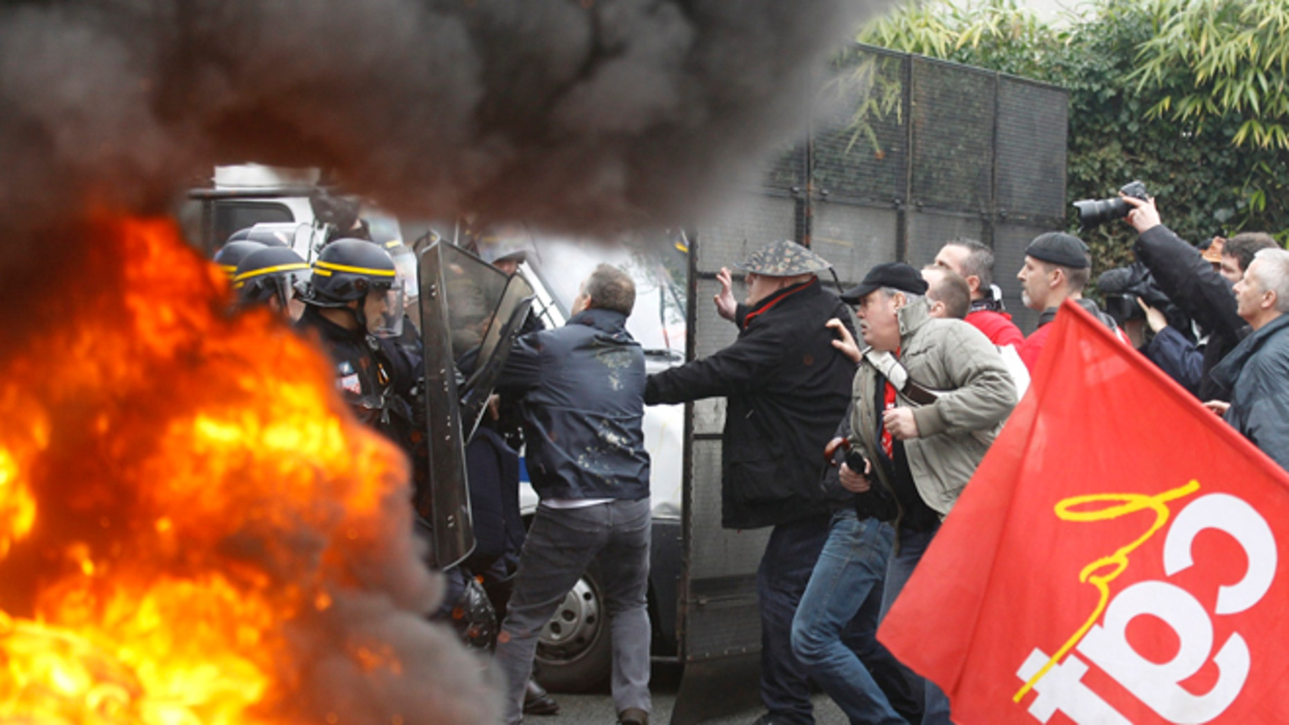March 7, 2013: Goodyear employees scuffle with riot policemen during a demonstration against layoffs, in front of Goodyear headquarters in Rueil Malmaison, west of Paris.