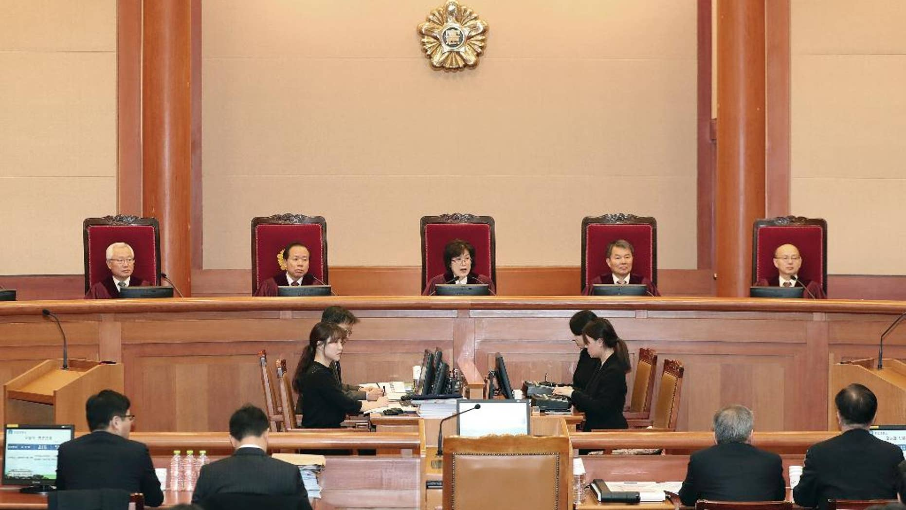 Judges of the Constitutional Court sit during a hearing on whether to confirm the impeachment of President Park Geun-hye, at the Court in Seoul, South Korea, Thursday, Feb. 9, 2017. Prosecutors say South Korea's impeached president has canceled plans to undergo questioning to protest leaks to the media about her investigation. (Kim Hyun-tae/Yonhap via AP)