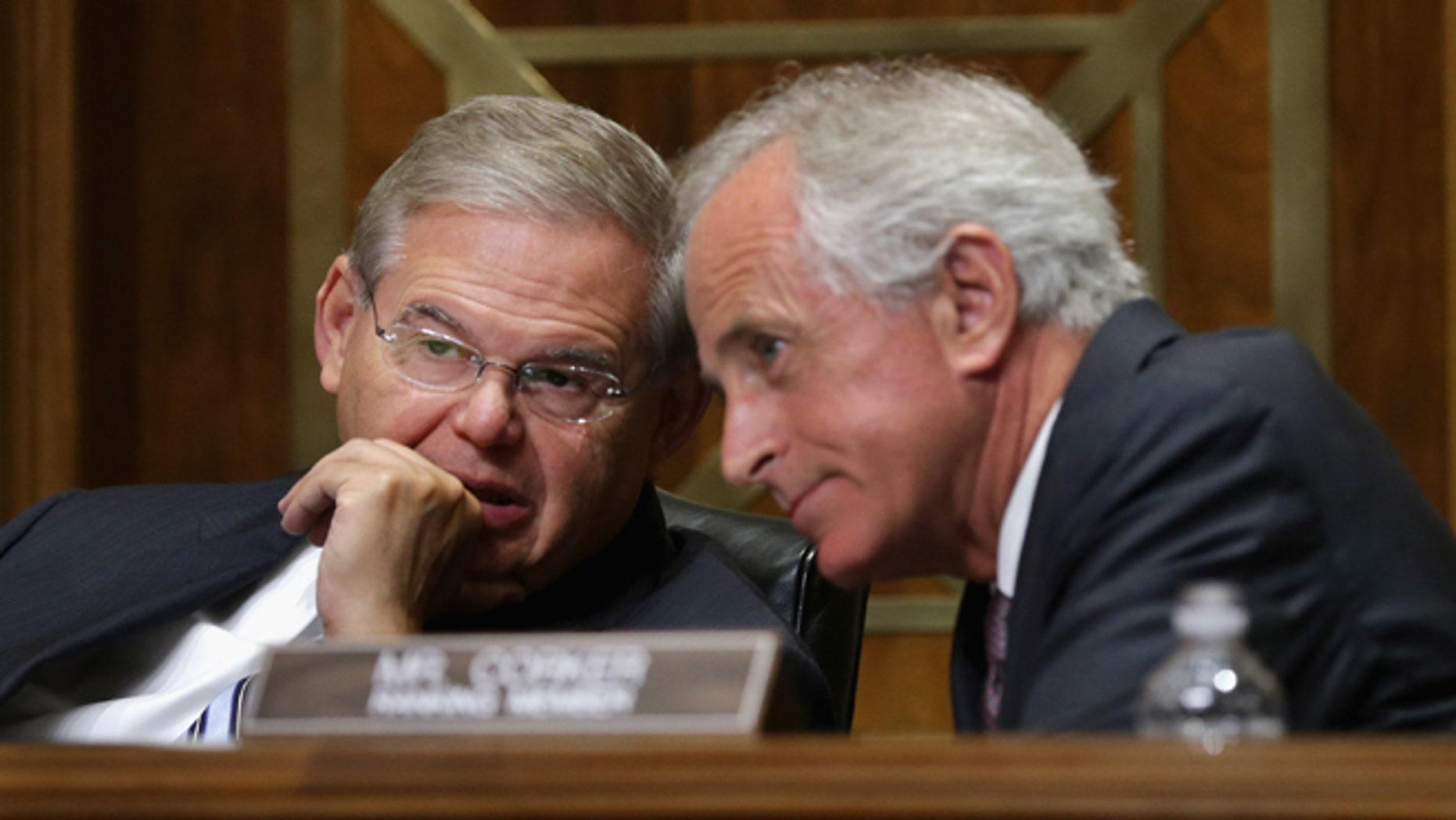 Sen. Robert Menendez, D-N.J., right, and Sen. Bob Corker, R-Tenn. talk on Capitol Hill in Washington. (Photo by Chip Somodevilla/Getty Images)