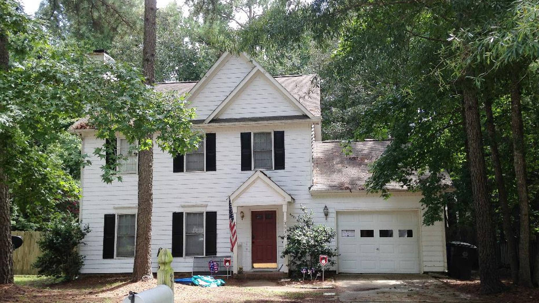 The home of Raleigh shooting suspect 39-year-old Chad Cameron Copley is seen Tuesday, Aug. 9, 2016, in Raleigh, N.C. Police say Copley fired a shotgun from inside his garage and fatally struck a 20-year-old black man. Witnesses say the body lay close to a mailbox. (AP Photo/Jonathan Drew)