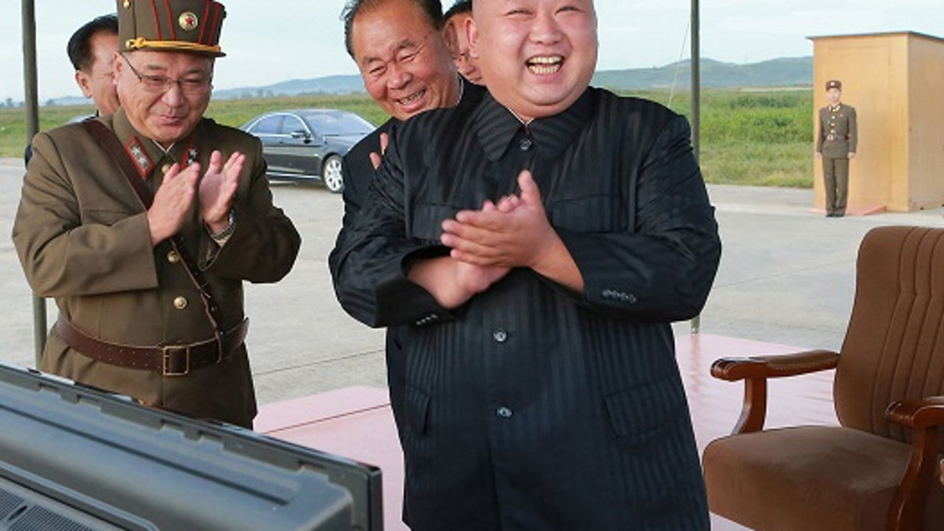 In this undated file photo distributed on Sept. 16, 2017, by the North Korean government, North Korean leader Kim Jong Un, right, celebrates what was said to be the test launch of an intermediate range Hwasong-12 missile at an undisclosed location in North Korea.