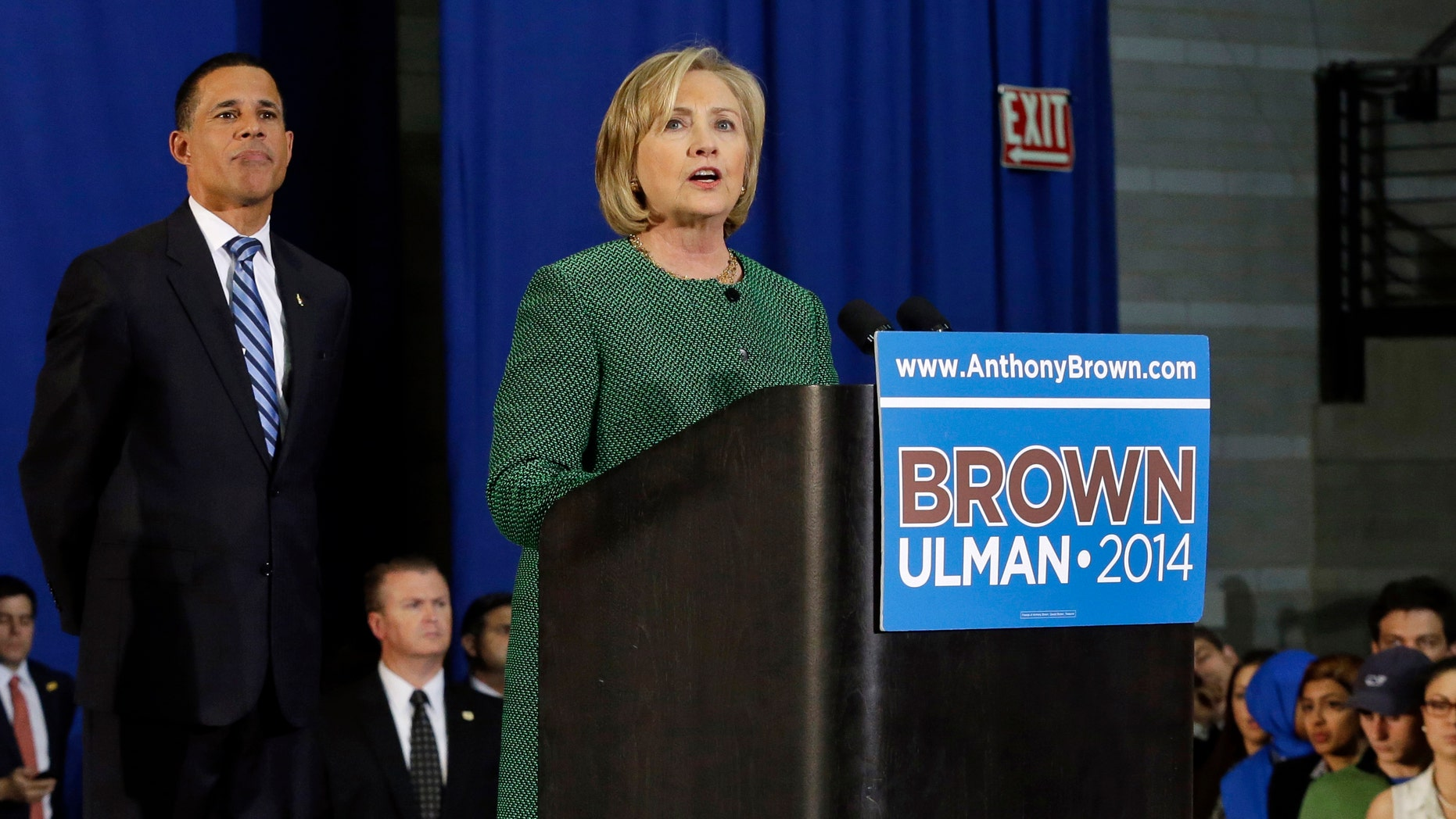 Former Secretary of State Hillary Rodham Clinton, right, campaigns for Maryland Democratic gubernatorial candidate, Lt. Gov. Anthony Brown, left, during a rally at the University of Maryland, Thursday, Oct. 30, 2014, in College Park, Md. (AP Photo/Patrick Semansky)