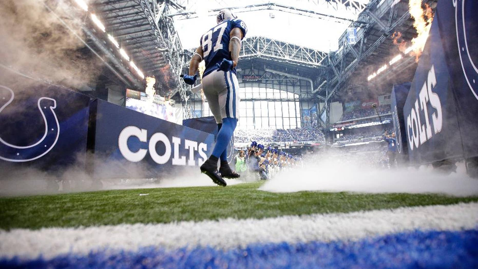 Indianapolis Colts wide receiver Reggie Wayne runs onto the field after being introduced before an NFL football game against the Cincinnati Bengals, Sunday, Oct. 19, 2014, in Indianapolis. (AP Photo/AJ Mast)