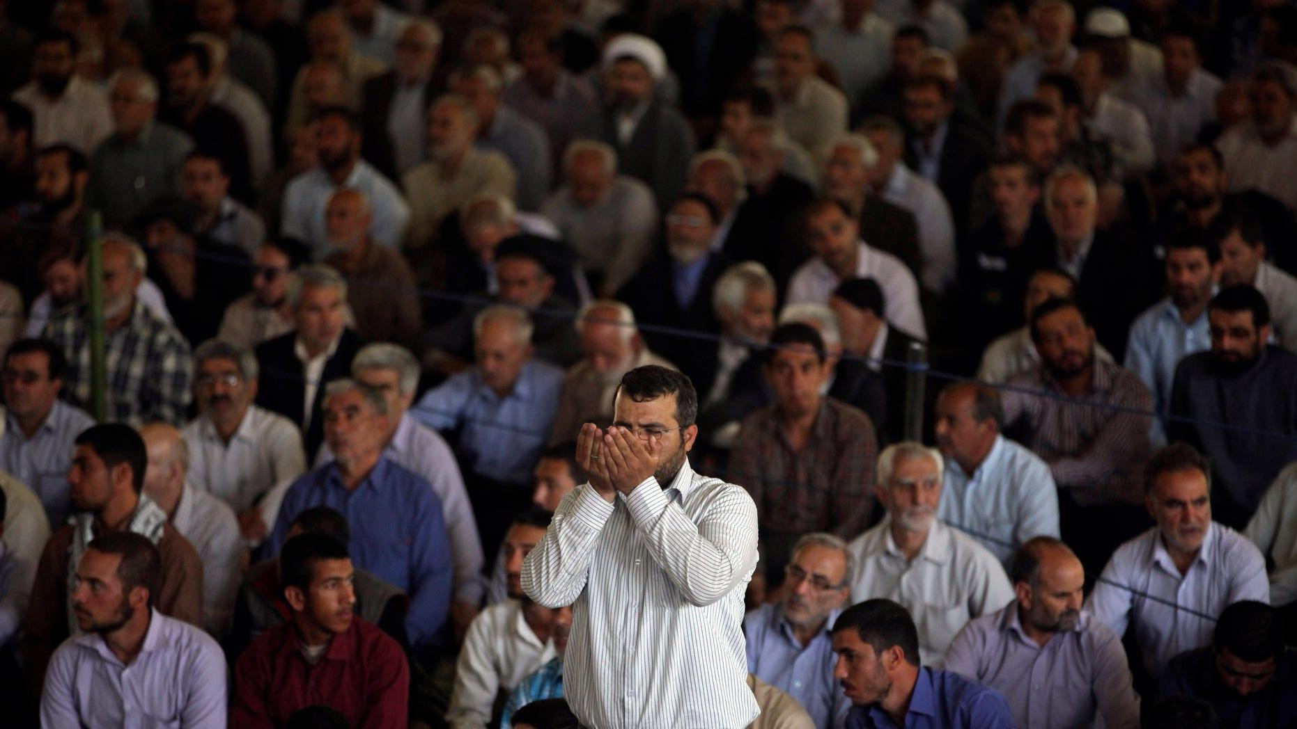 An Iranian worshipper prays at the start of Friday prayers at Tehran University in Tehran, Iran, Friday, May 17, 2013. (AP Photo/Vahid Salemi)