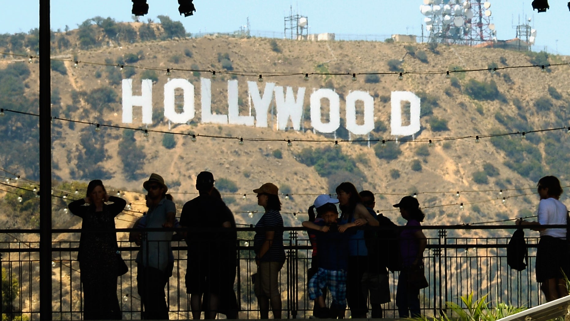 LOS ANGELES, CA - JUNE 28:  Tourists are slihouted against the distroted Hollywood sign from rising heat waves during a major heat wave in Southern California on June 28, 2013 in Los Angeles, California. Temperatures are expected to be in the triple digits in most areas of Southern California. According to the national Weather Service, the heat wave is expected to linger into early next week prompting heat advisories and opening of cooling centers.  (Photo by Kevork Djansezian/Getty Images)