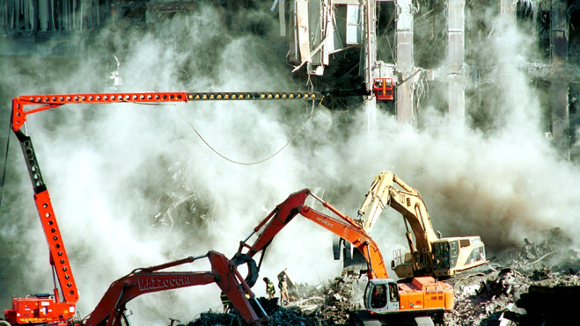 396041 01: Weeks after the World Trade Center attacks, firefighters keep clearing the rubble October 17, 2001 in New York. A section of the facade from the south tower of the World Trade Center was brought down with a cloud of dust Tuesday as cleanup of the disaster site entered its sixth week. (Photo by Shaul Schwarz/Getty Images)