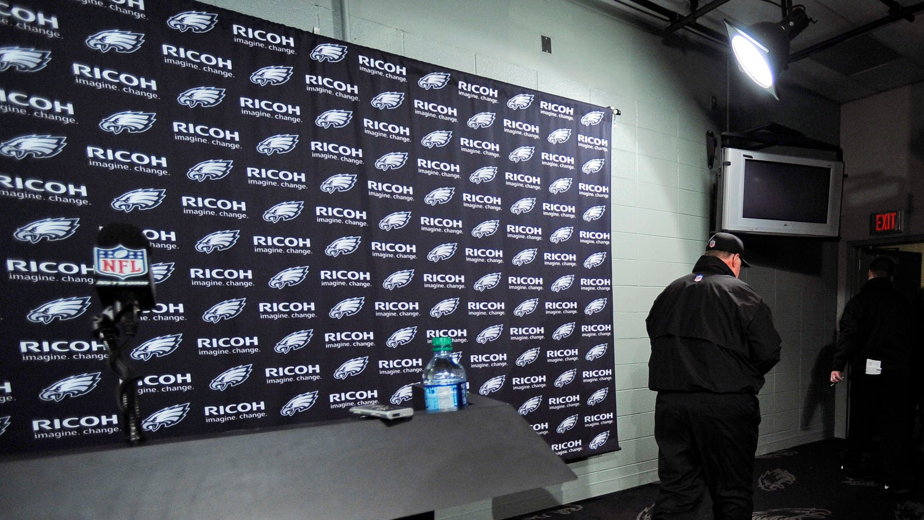 Philadelphia Eagles coach Andy Reid leaves after a news conference following an NFL football game against the Washington Redskins, Sunday, Dec. 23, 2012, in Philadelphia. Washington won 27-20. (AP Photo/Michael Perez)