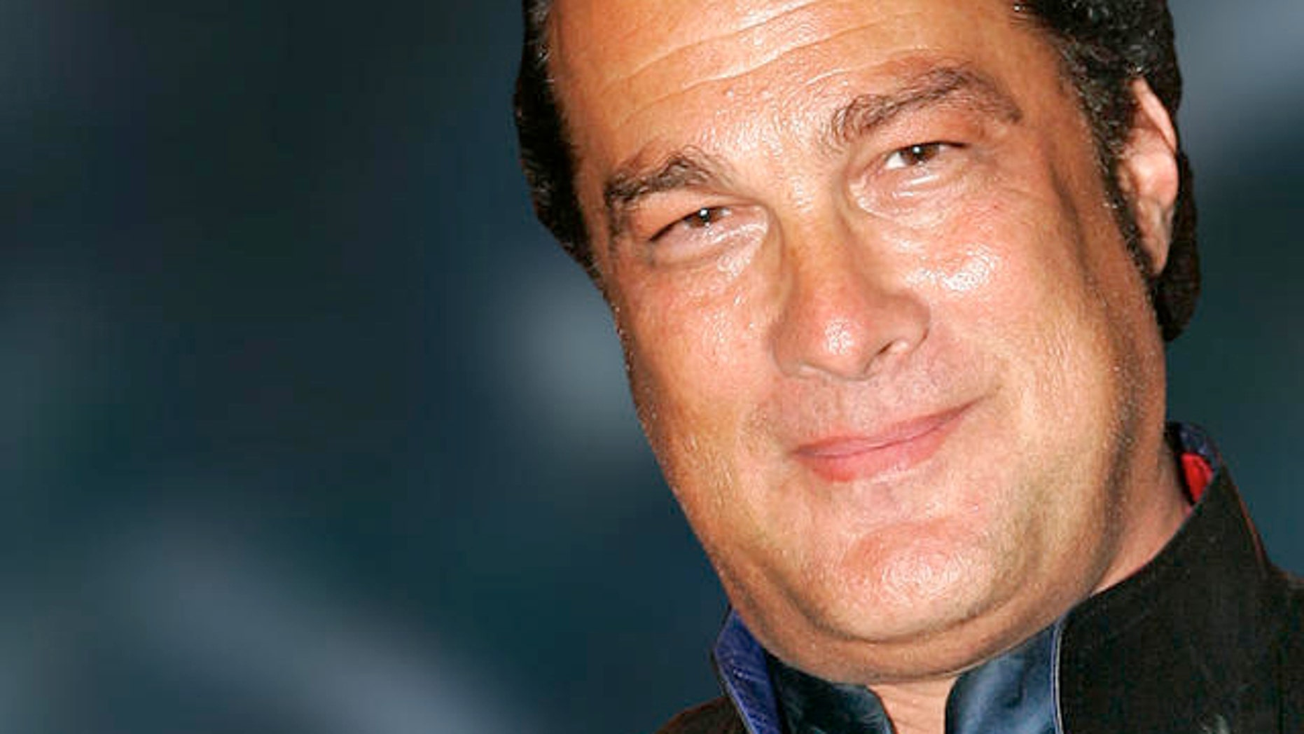 """Actor Steven Seagal poses at the """"Jammin for Ray"""" Post-Grammy Party for Ray Charles, Sunday night, Feb. 13, 2005, at Spagos in Beverly Hills, Calif. The late singer won eight Grammys Sunday night. (AP Photo/Mark J. Terrill)"""