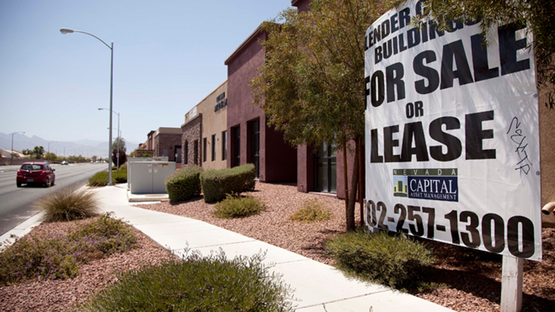 June 21, 2012: A sign advertising empty professional office space for sale or lease is posted outside a building in North Las Vegas, Nev.