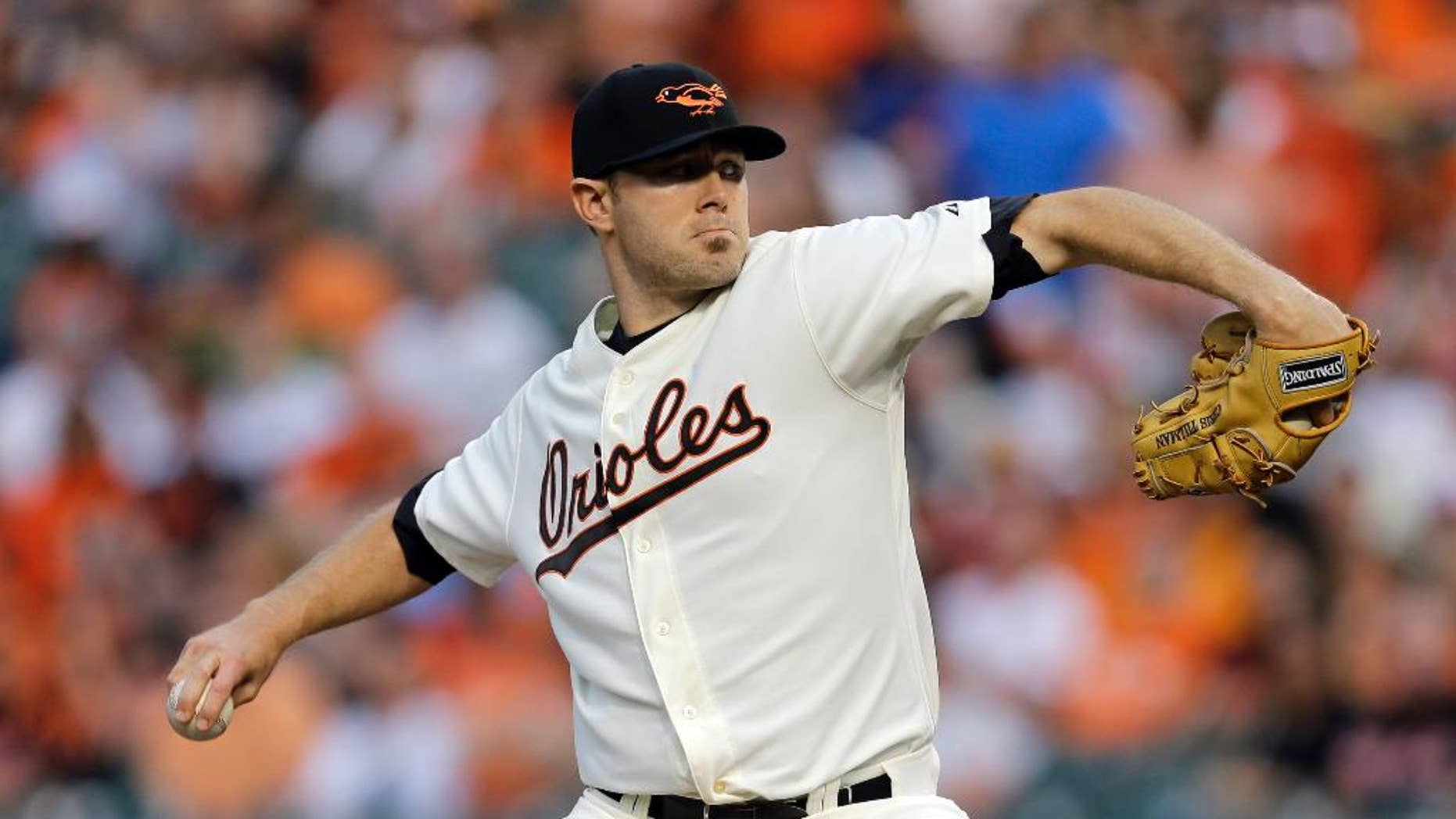 Baltimore Orioles starting pitcher Chris Tillman throws to the St. Louis Cardinals in the first inning of an interleague baseball game, Friday, Aug. 8, 2014, in Baltimore. (AP Photo/Patrick Semansky)